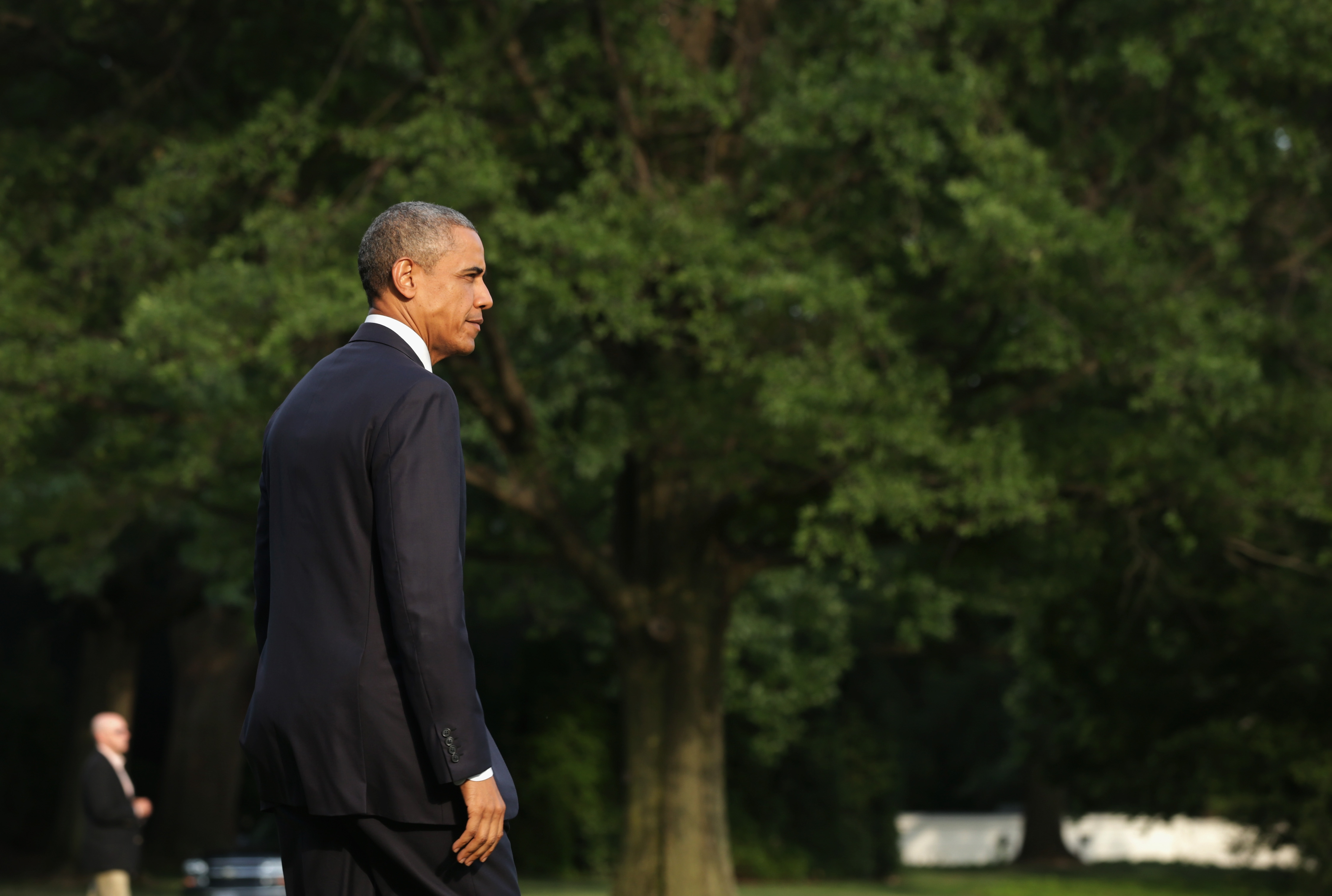 U.S. President Barack Obama walks towards to the Marine One on the South Lawn prior to his departure from the White House July 18, 2014 in Washington, D.C.