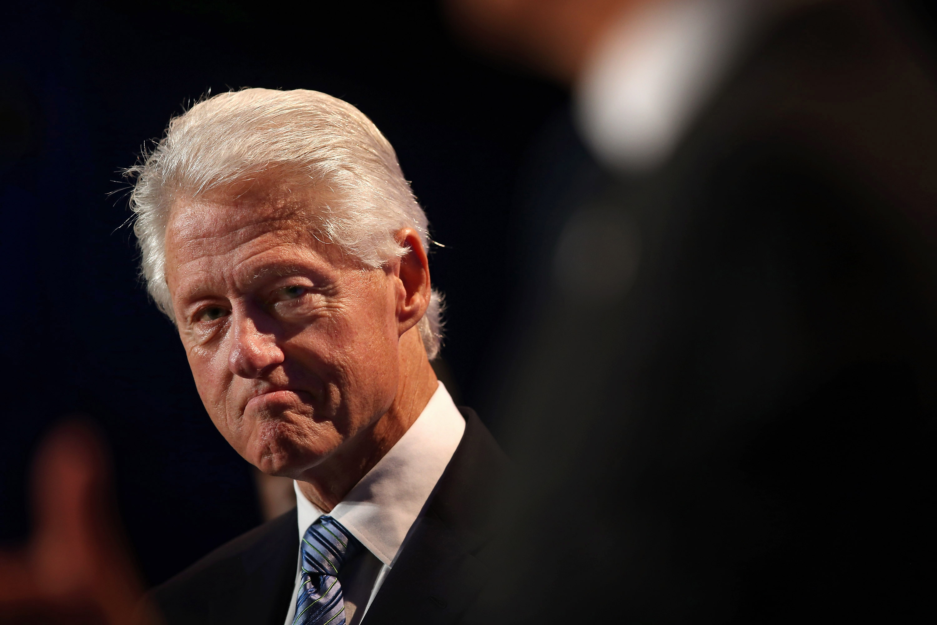 Former President Bill Clinton listens as Chicago Mayor Rahm Emanuel speaks to guests at the Clinton Global Initiative (CGI) on June 13, 2013 in Chicago, Illinois.