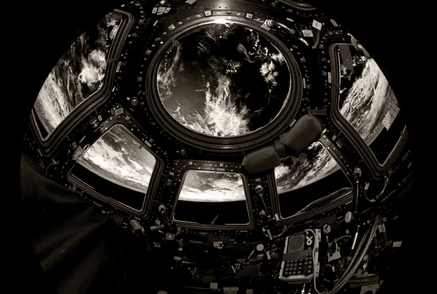 International Space Station Cupola windows with Earth view, rendered in B&W.                                 (Taken with an 8mm fisheye lens.)
