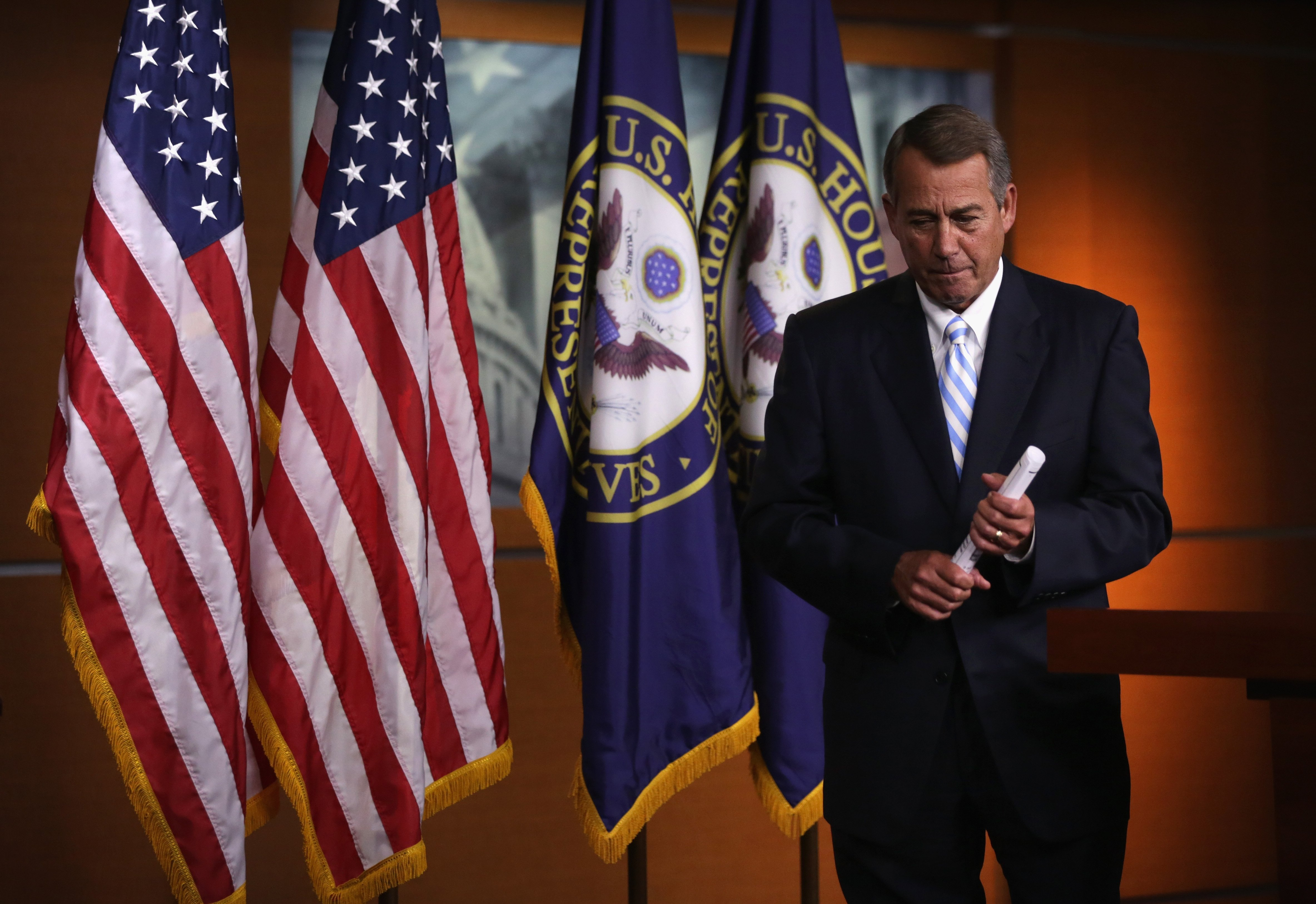 U.S. Speaker of the House Rep. John Boehner leaves after a press briefing July 31, 2014 on Capitol Hill in Washington.