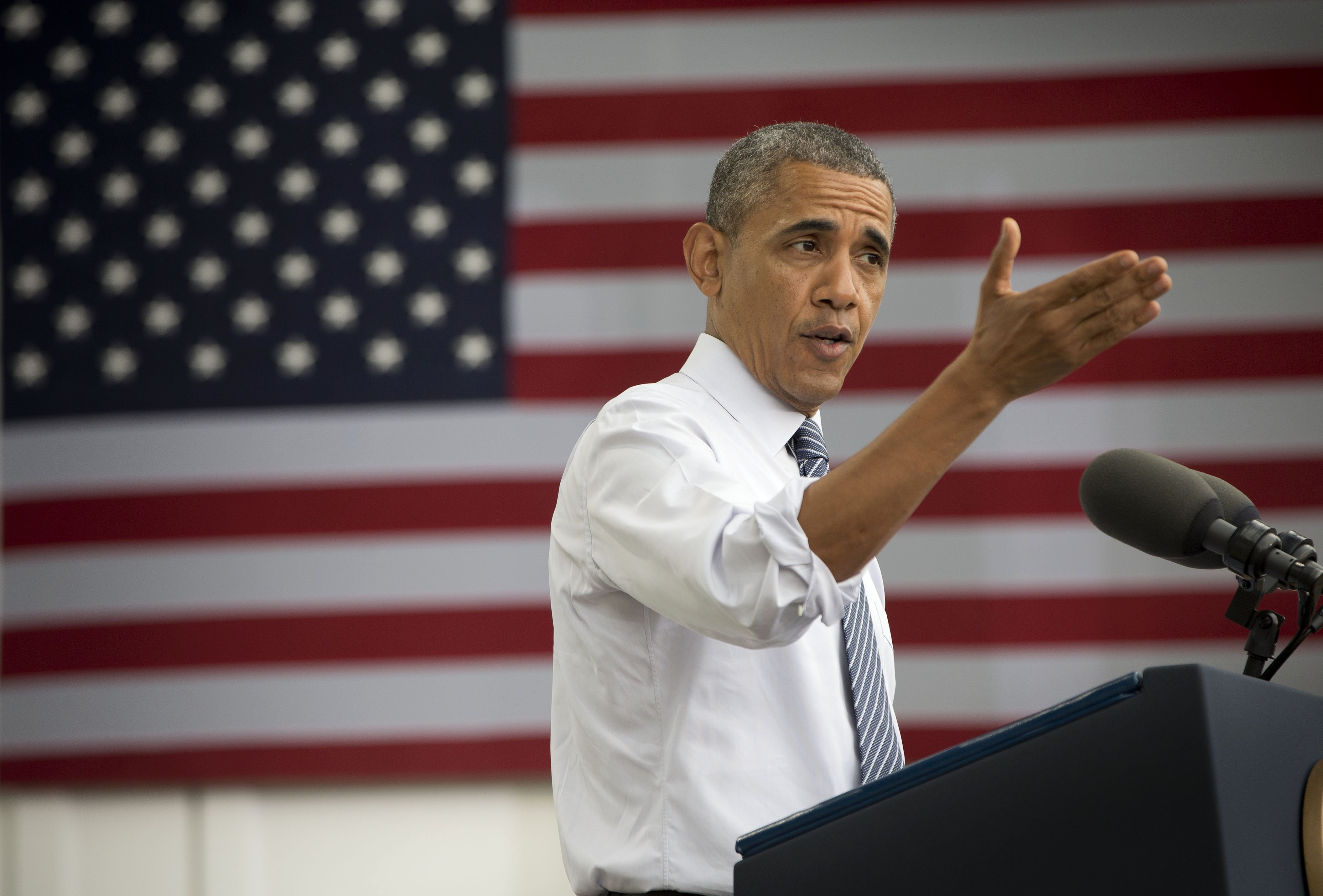 President Barack Obama gestures while speaking about the economy at Lake Harriet Band Shell in Minneapolis on June 27, 2014