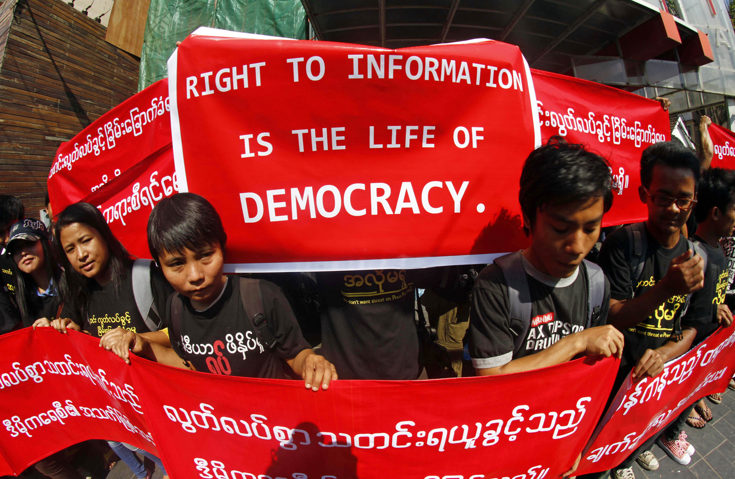 Burmese journalists hold banners as they protest for press freedom outside the office of the Daily Eleven newspaper in Rangoon on Jan. 7, 2014.