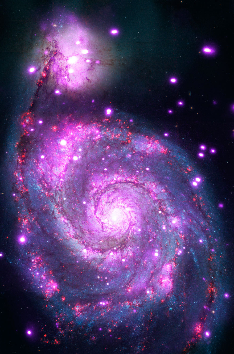 Like the Milky Way, the  Whirlpool Galaxy  (Messier 51 or NGC 5194) is a spiral with spectacular arms of stars and dust. It is located 30 million light years from Earth, and its face-on orientation gives us a perspective that we can never get of our own spiral home.