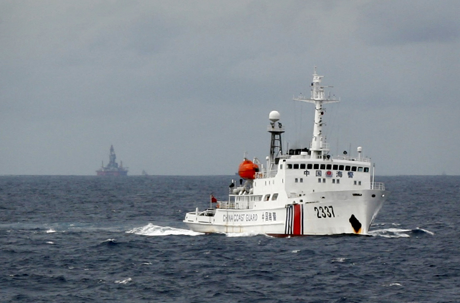 A Chinese coast-guard vessel passes near the Chinese oil rig Haiyang Shiyou 981 in the South China Sea, about 210 km (130 miles) from the coast of Vietnam on June 13, 2014.