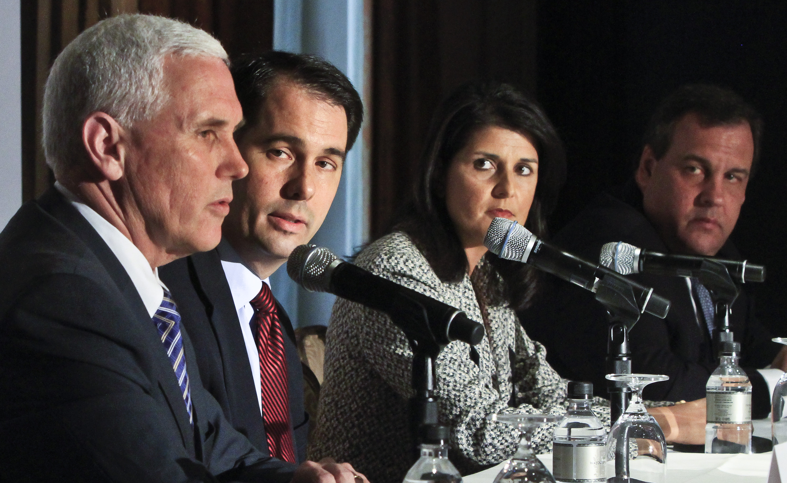 Wisconsin Gov. Scott Walker,  South Carolina Gov. Nikki R. Haley and New Jersey Gov. Chris Christie listen as Indiana Gov. Mike Pence speaks during a press conference at the Republican Governors Association's quarterly meeting on Wednesday May 21, 2014 in New York.