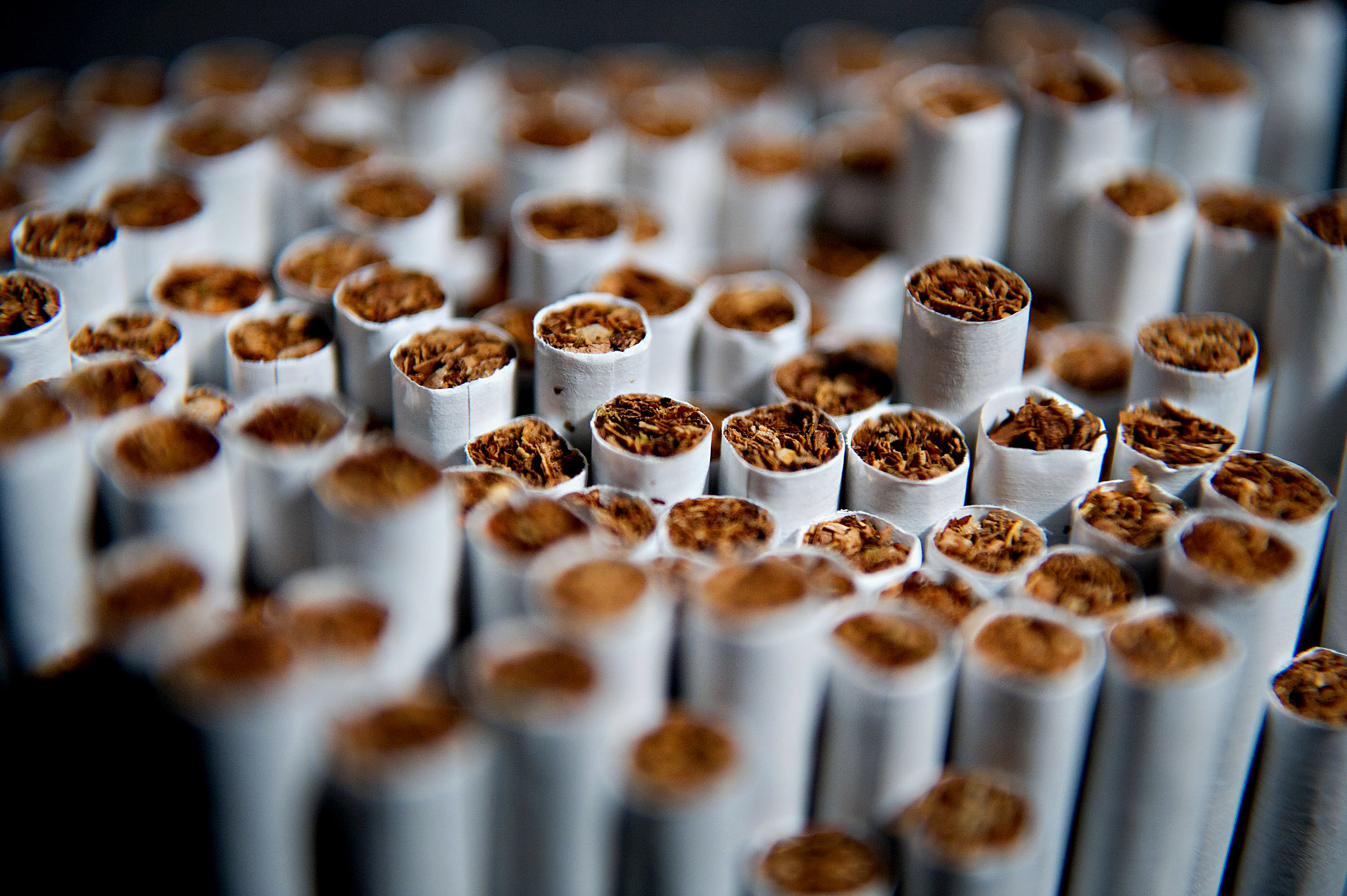 Several brands of cigarettes are arranged for a photograph in Tiskilwa, Illinois, U.S., on April 17, 2012.