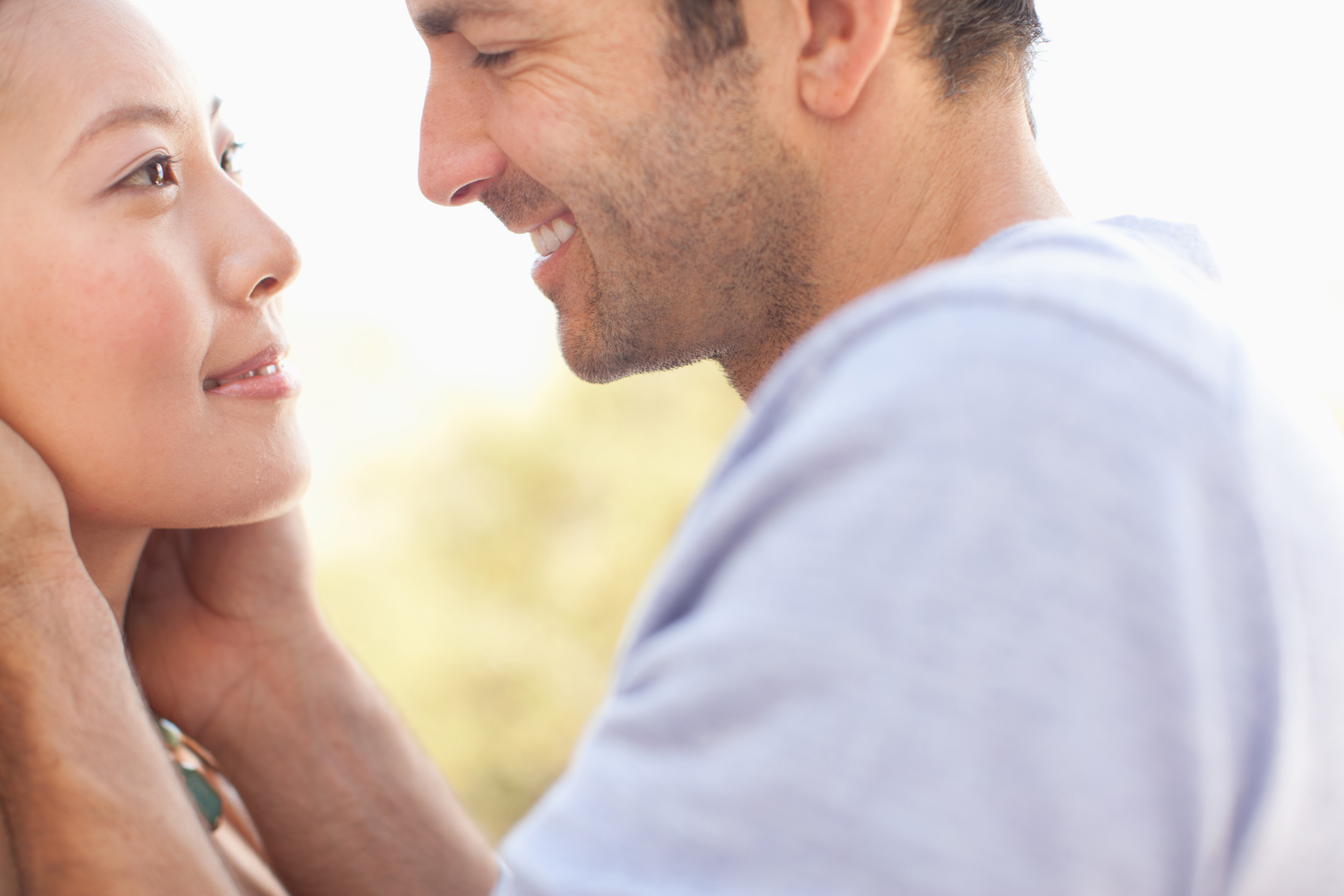 A close-up of a smiling couple is shown.