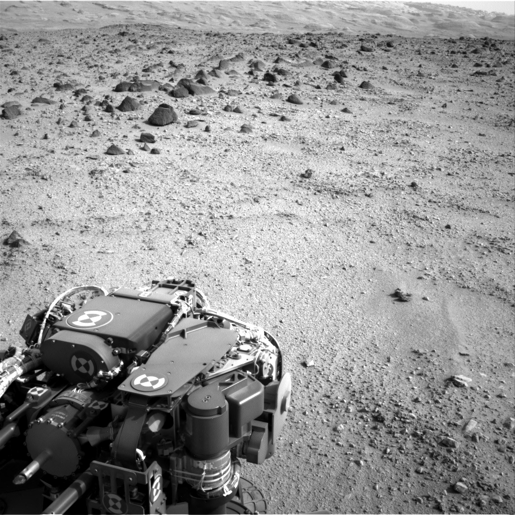 The lower slopes of Mount Sharp appear at the top of this image taken by the right Navigation Camera (Navcam) of NASA's Mars rover Curiosity at the end of a drive of about 135 feet (41 meters) during the 329th Martian day, or sol, of the rover's work on Mars (July 9, 2013).