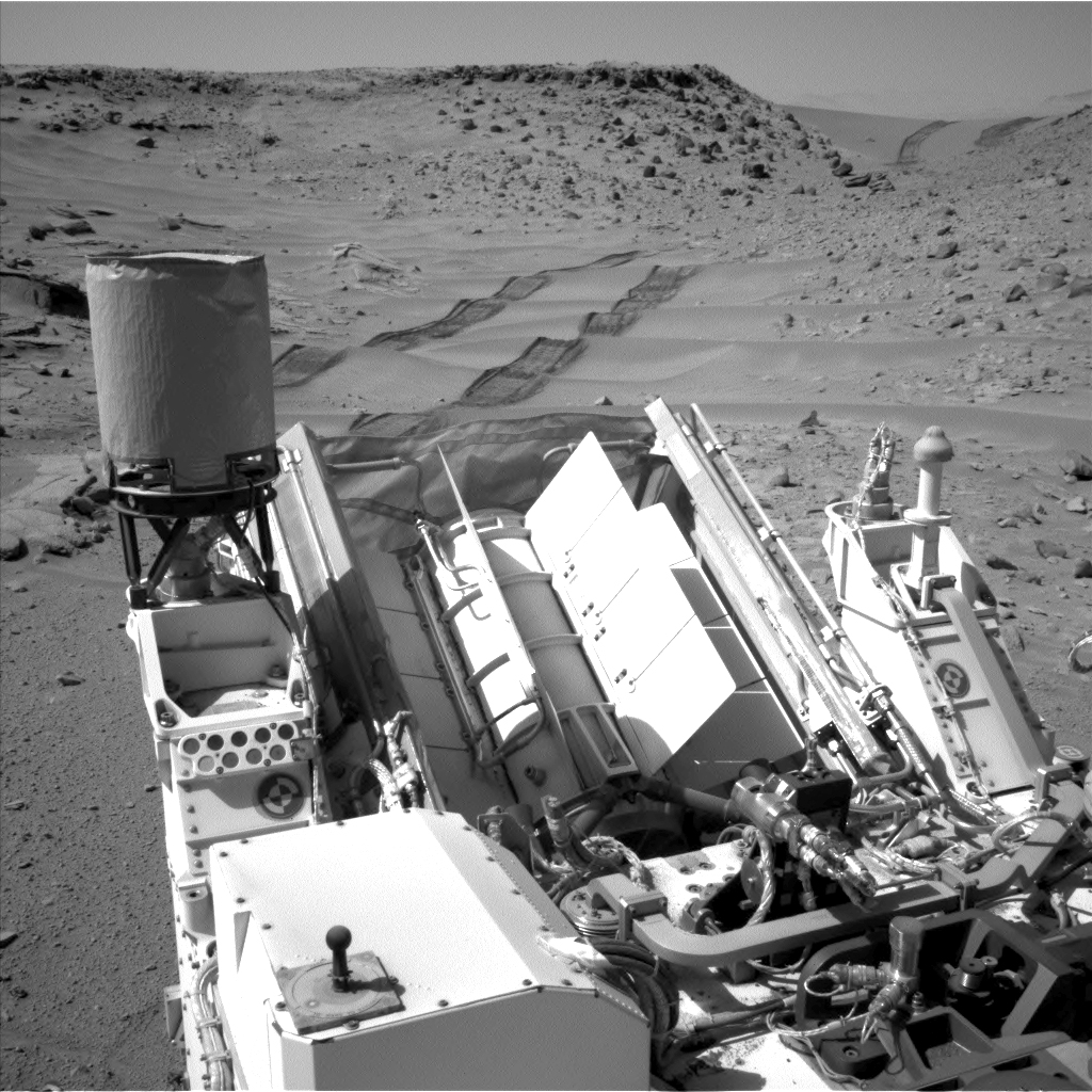 NASA's Curiosity Mars rover used the Navigation Camera (Navcam) on its mast to catch this look-back eastward at wheel tracks from driving through and past  Dingo Gap  inside Gale Crater. The gap, spanned by a 3-foot-tall (1-meter-tall) dune, is at the right-hand side of the horizon in this scene.