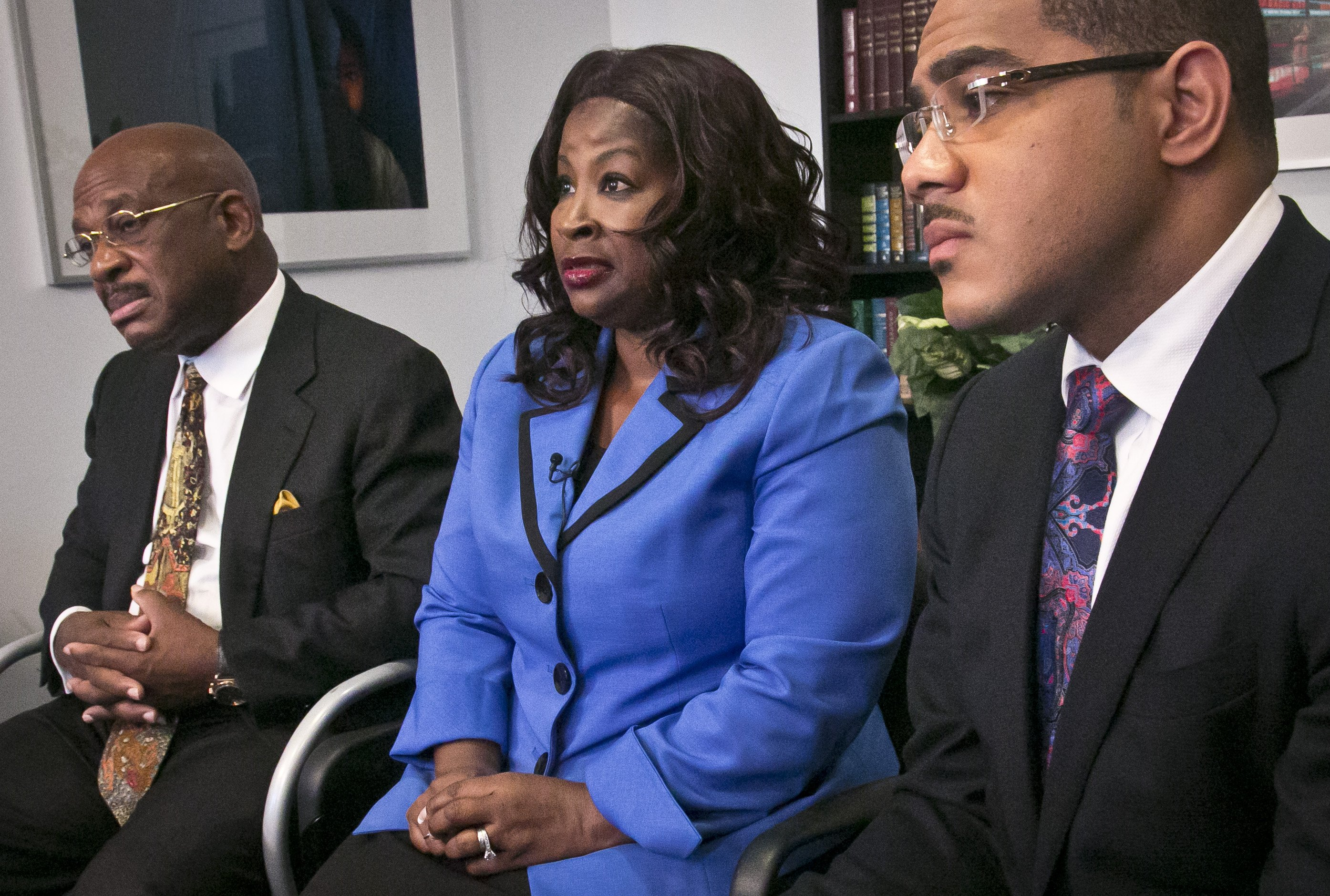 Cynthia Robinson with her attorneys Willie Gary (left) and Christopher Chestnut (right) as she speaks during an interview on July 21, 2014 in New York City.