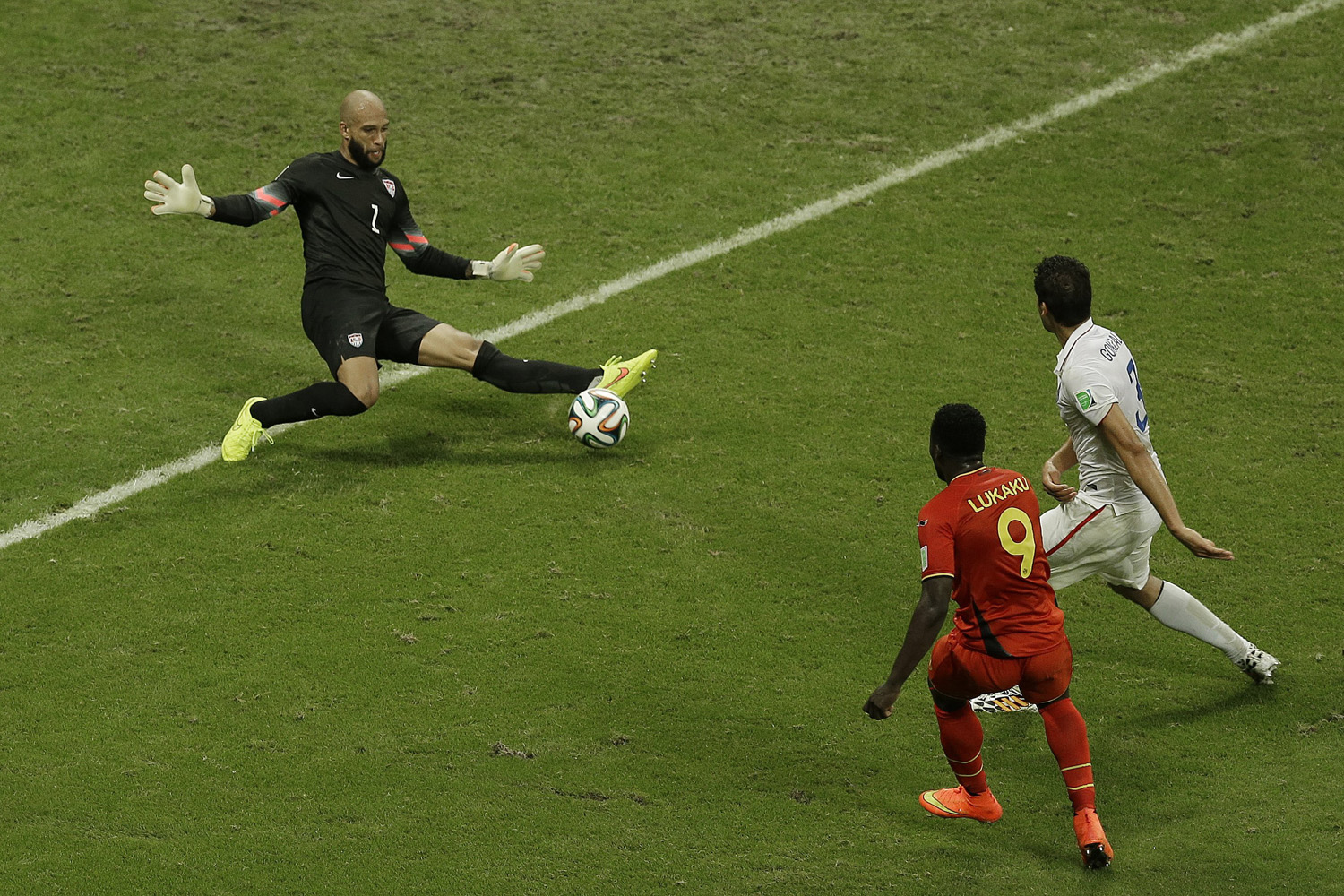 Jul. 1, 2014. United States' goalkeeper Tim Howard, left, makes a save as Belgium's Romelu Lukaku, front, looks on during the World Cup round of 16 soccer match between Belgium and the USA at the Arena Fonte Nova in Salvador, Brazil.