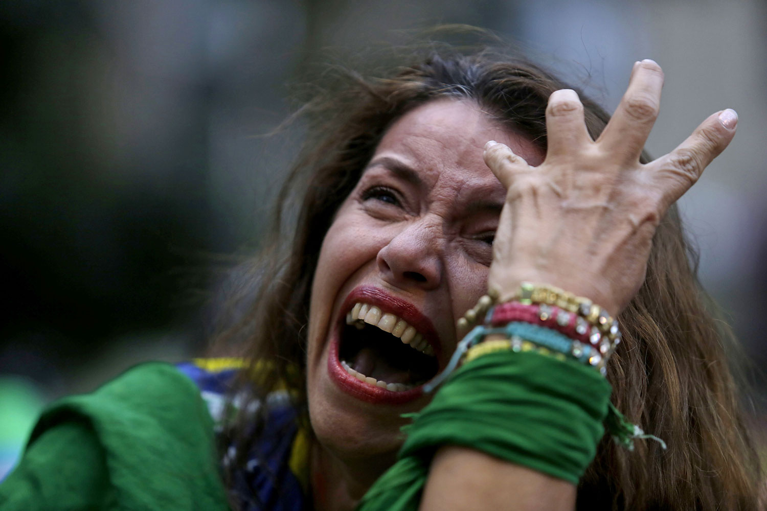 A Brazil soccer fan cries as Germany scores against her team at a semifinal World Cup match as she watches the game on a live telecast in Belo Horizonte, Brazil, July 8, 2014.