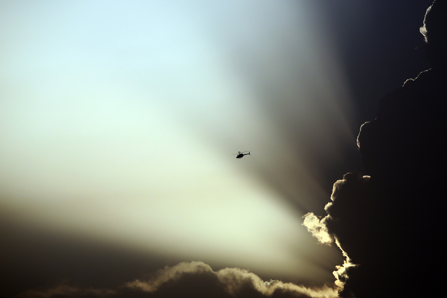 Jul. 17, 2014. A U.S. helicopter flies during clashes between Taliban fighters and Afghan government forces in Kabul, Afghanistan.