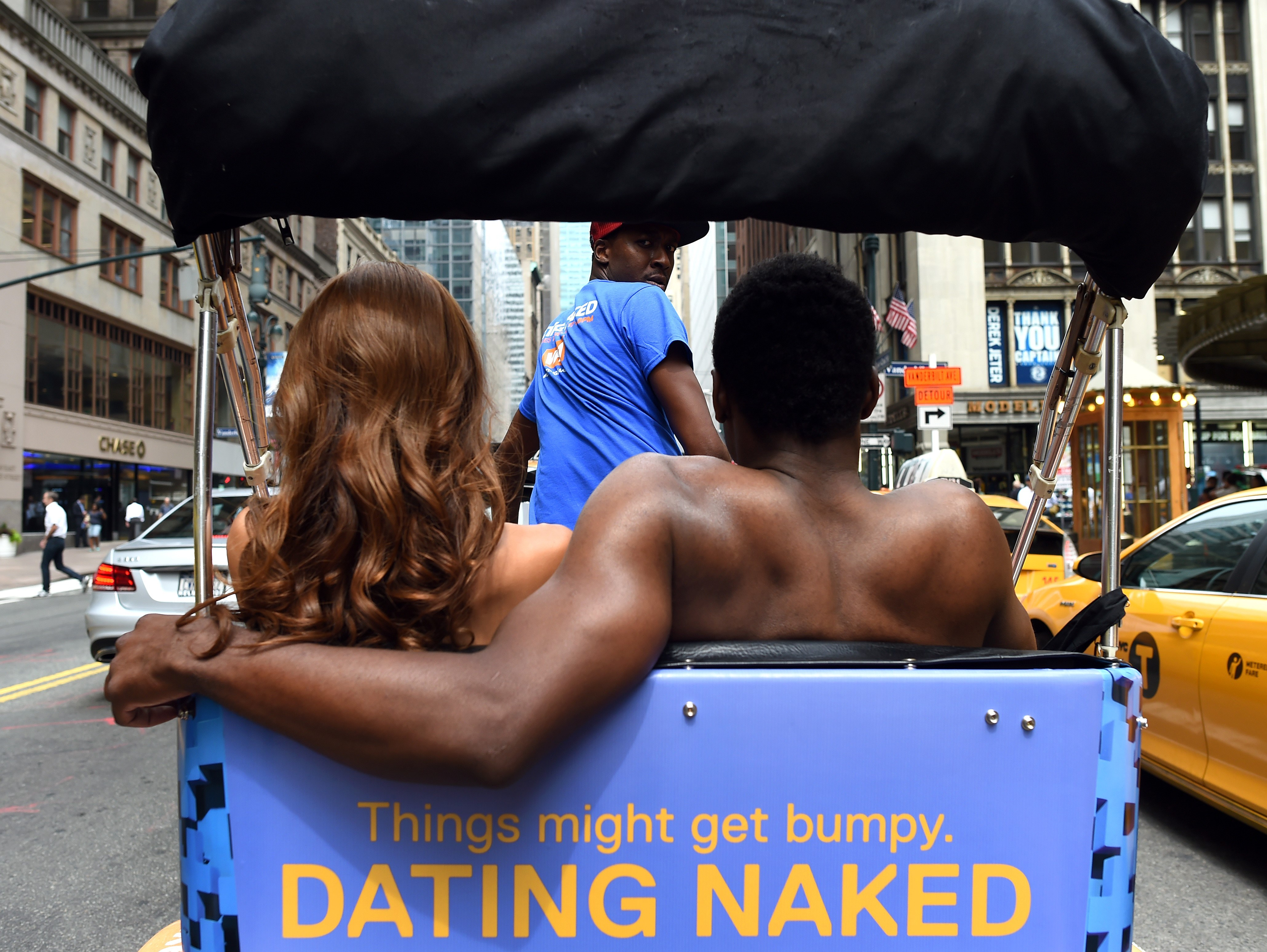 Kelly Keodara and Yarc Lewinson ride around Grand Central Station in New York City on July 16, 2014 in a pedicab to promote a new  VH1 series  Dating Naked .