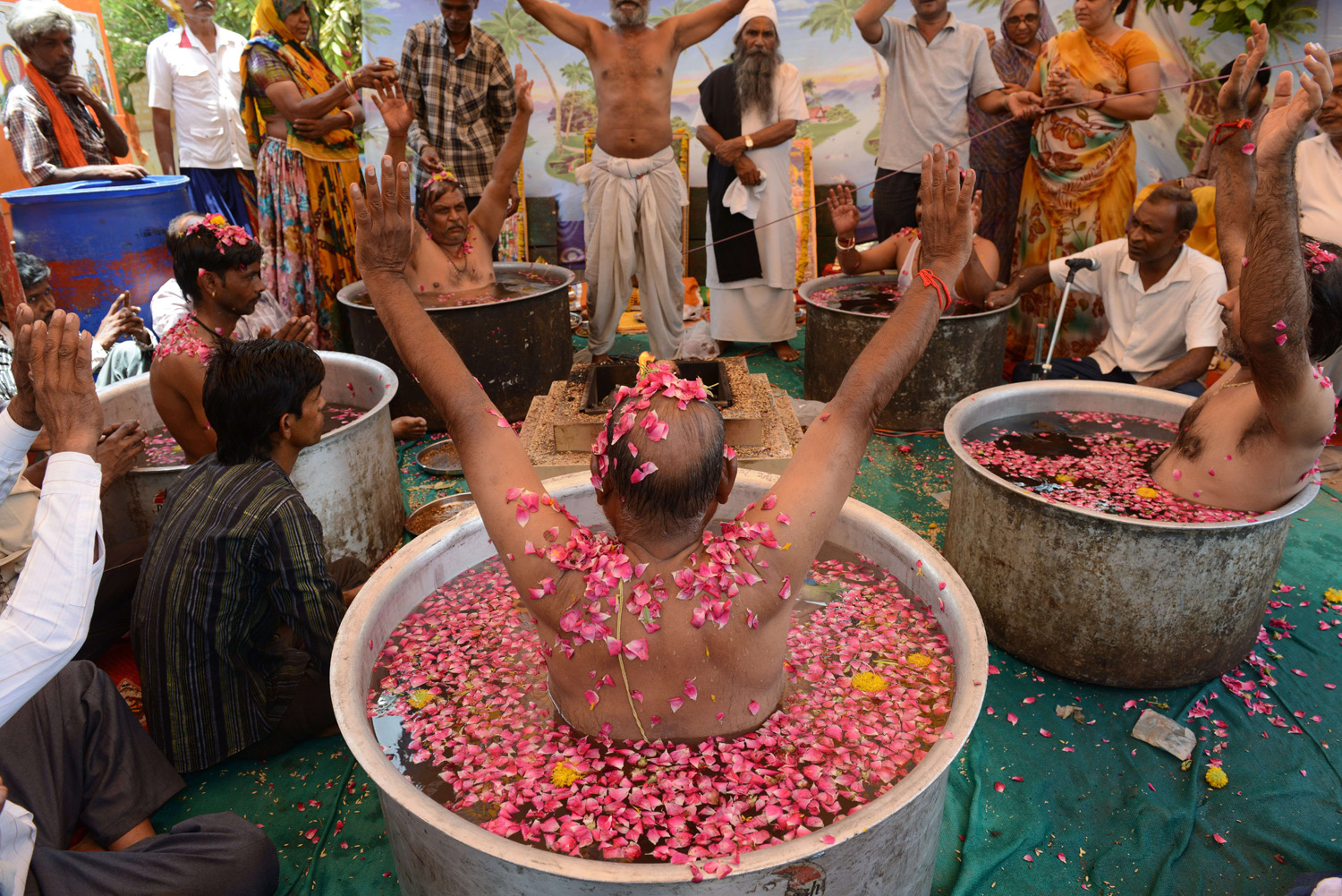 Indian Hindu Brahmins perform rituals to appease the Rain God on the outskirts of Ahmedabad, India on July 1, 2014.