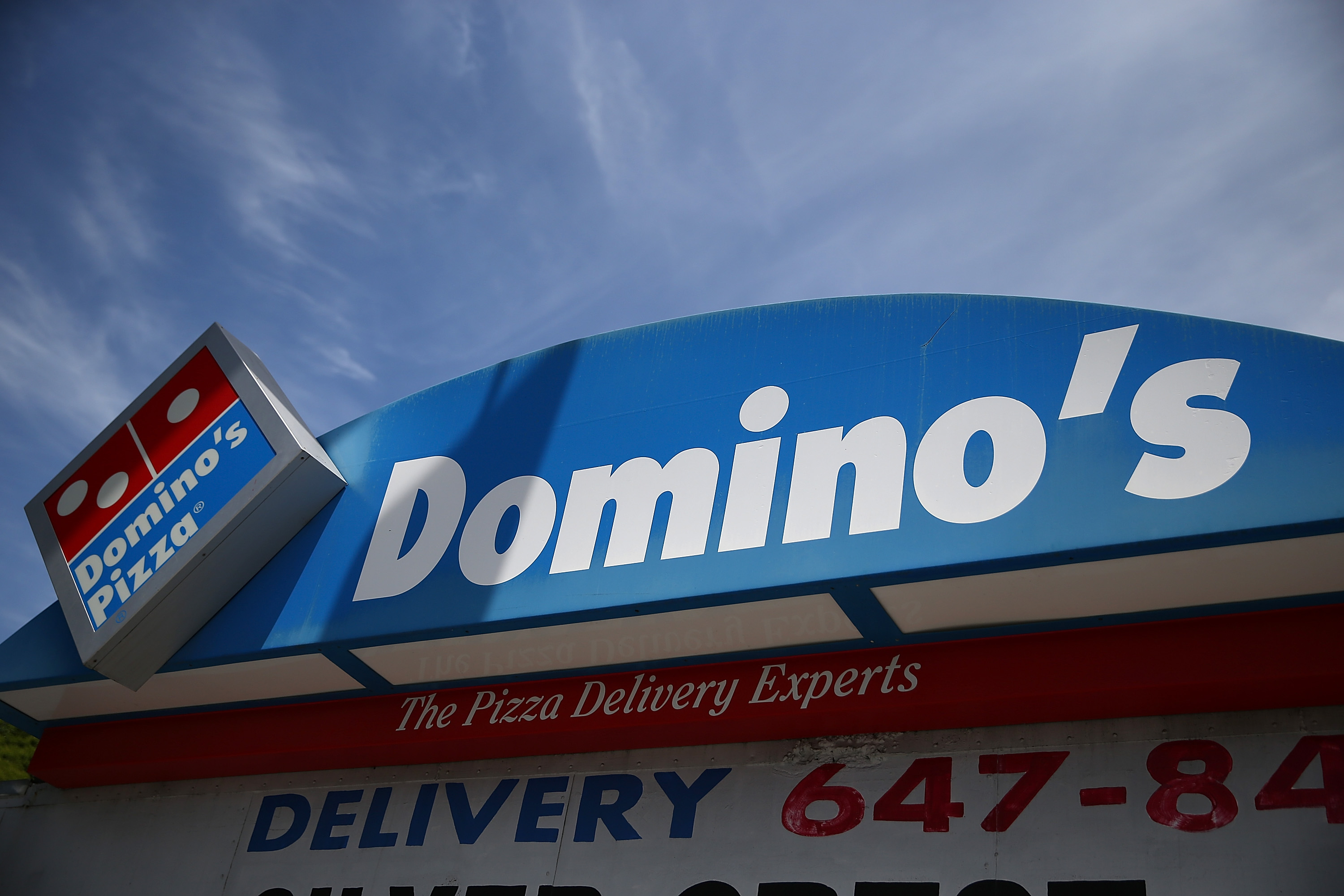 A sign is posted outside of a Domino's Pizza restaurant on May 1, 2014 in San Francisco, California.