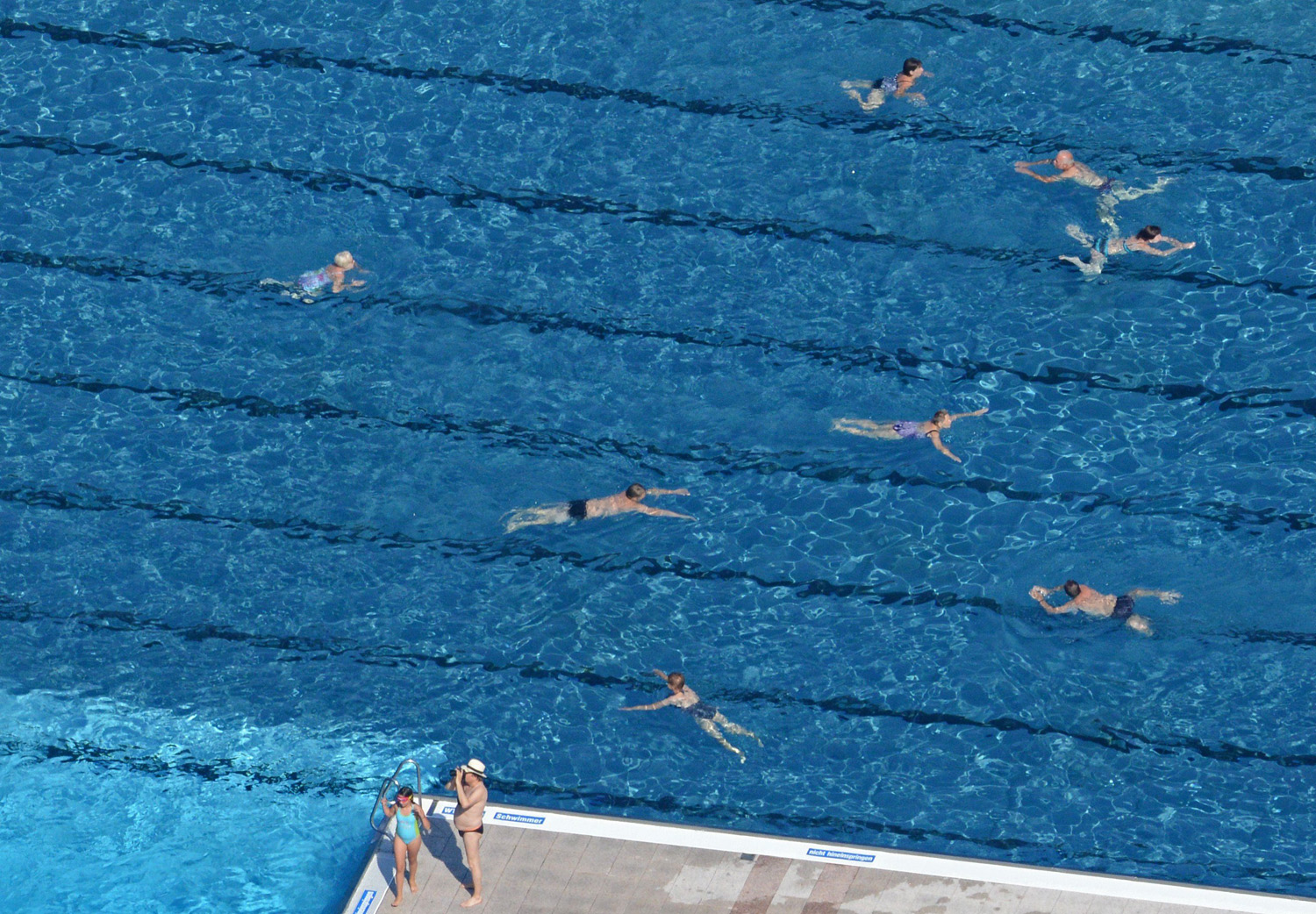 People swim at the Massenei open air public swimming pool in Grossroehrsdorf, Germany on July 19, 2014.