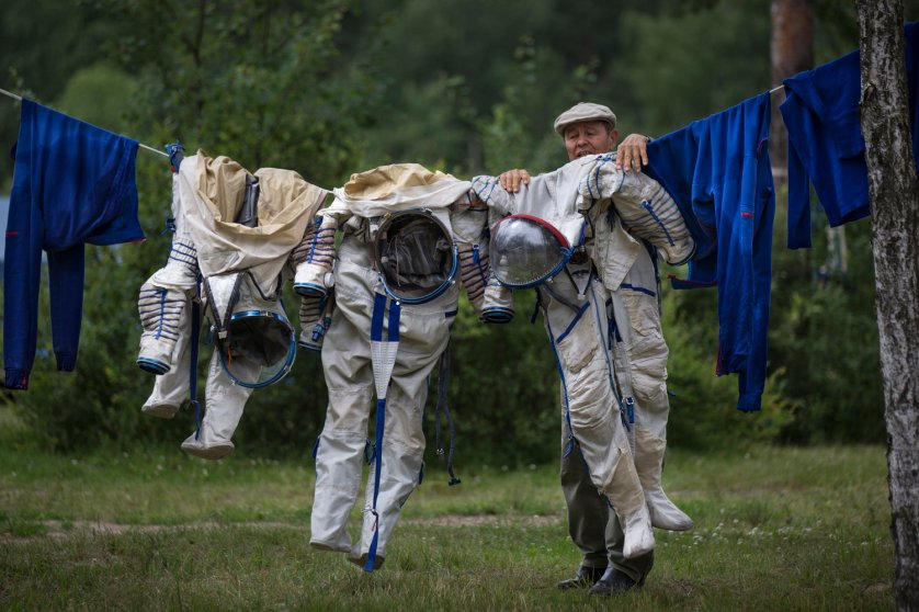 An employee at the Russian Space Training Center hangs space suits out to dry after training in Noginsk, Russia on July 2, 2014.