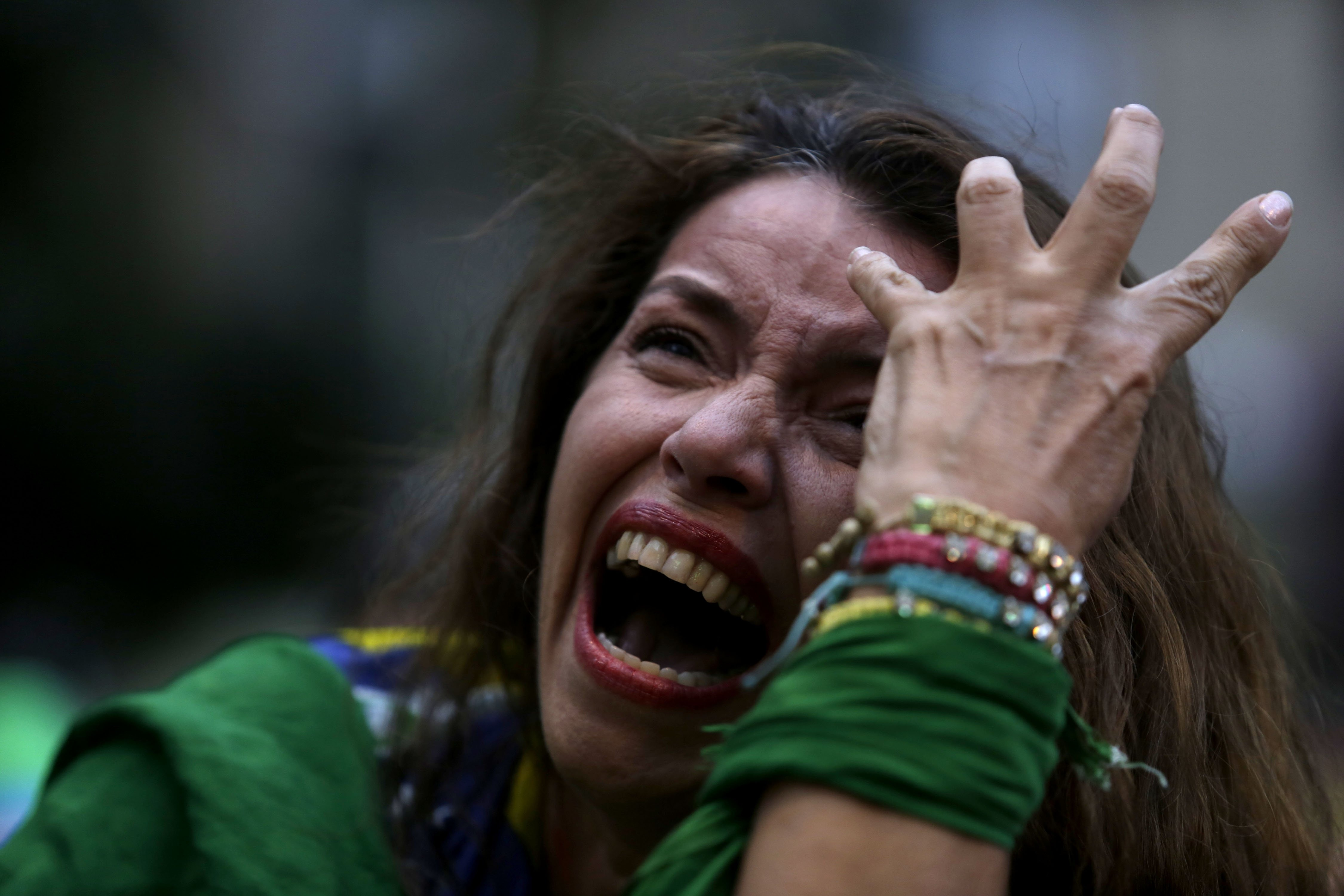 A Brazilian soccer fan cries as she watches her team get beat during a live telecast of the semifinals World Cup soccer match between Brazil and Germany, in Belo Horizonte, Brazil on July 08, 2014.