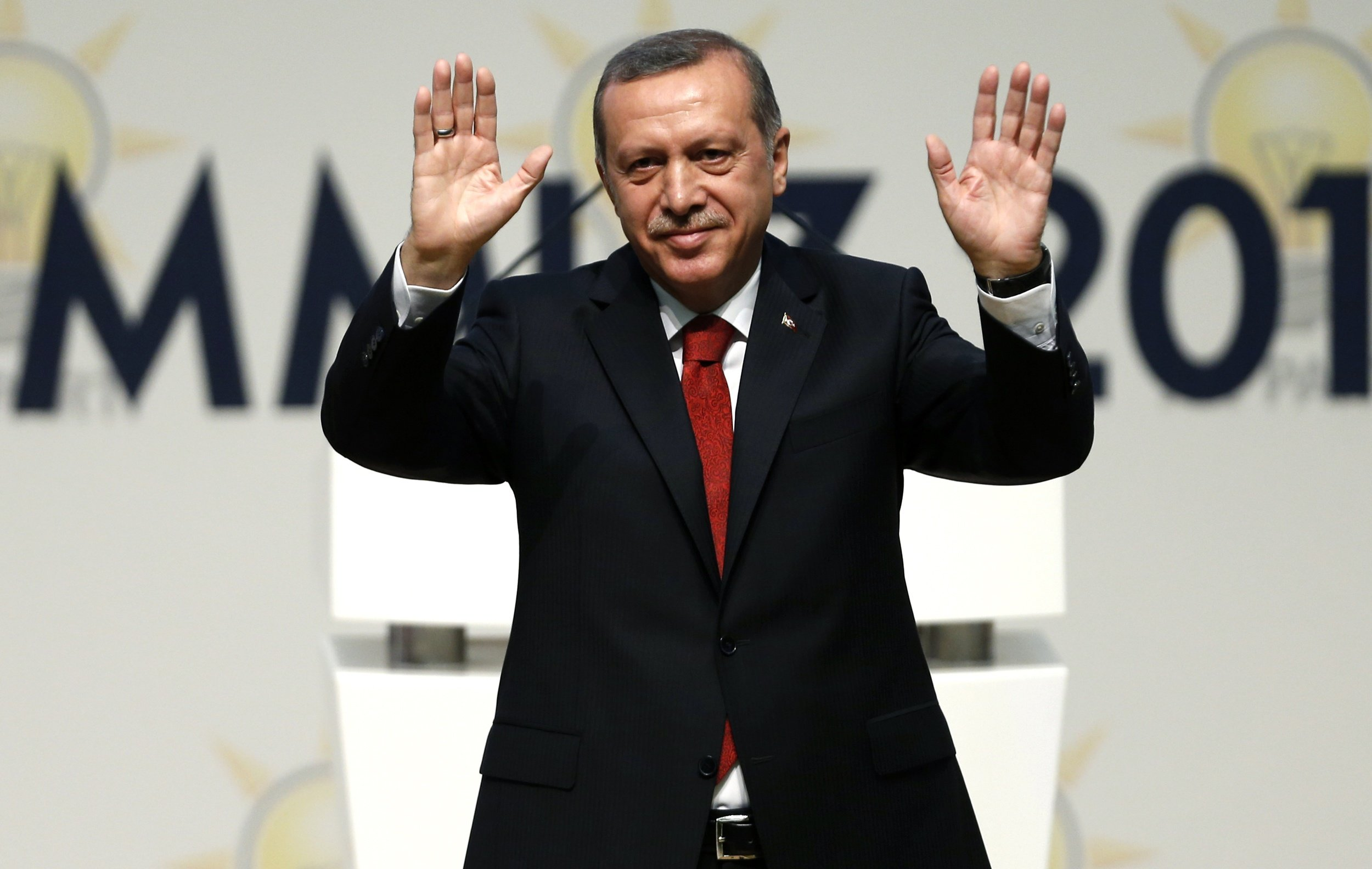 Turkey's Prime Minister Recep Tayyip Erdogan greets Justice and Development Party members at a meeting, in which he is named as his party's candidate for the country's first direct presidential election, in Ankara on July 1, 2014