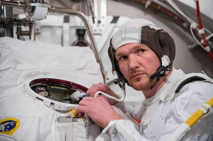 Astronaut Alexander Gerst participates in an Extravehicular Mobility Unit (EMU) spacesuit fit check, in the Space Station Airlock Test Article (SSATA) of the Crew Systems Laboratory at NASA's Johnson Space Center.