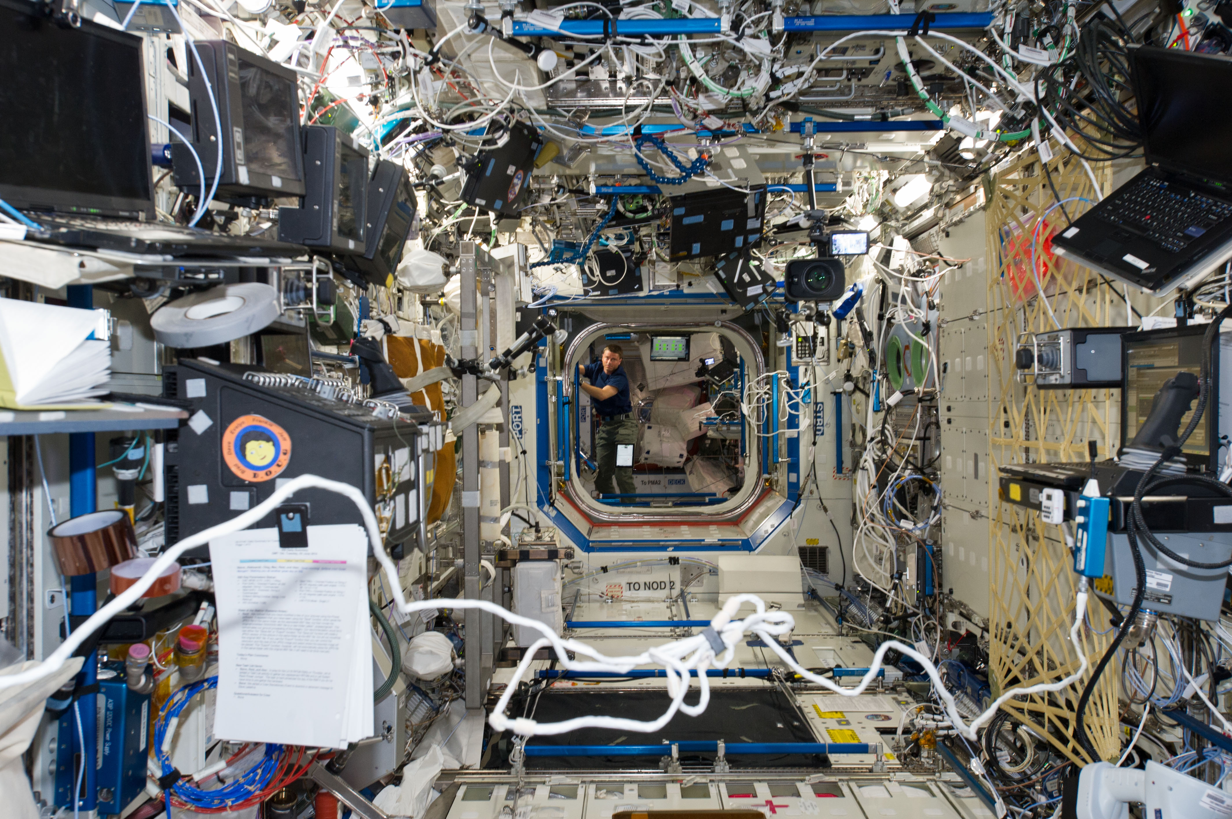 Photographed from the Destiny laboratory, NASA astronaut Reid Wiseman,  is in the Harmony node of the International Space Station.