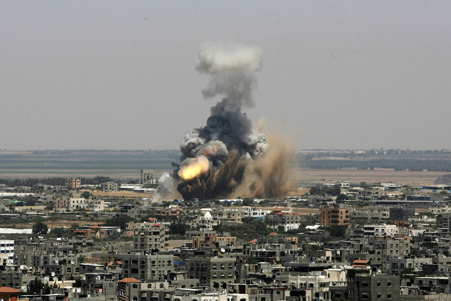 Jul. 8, 2014. An Israeli missile explodes on impact in Rafah, southern Gaza Strip.