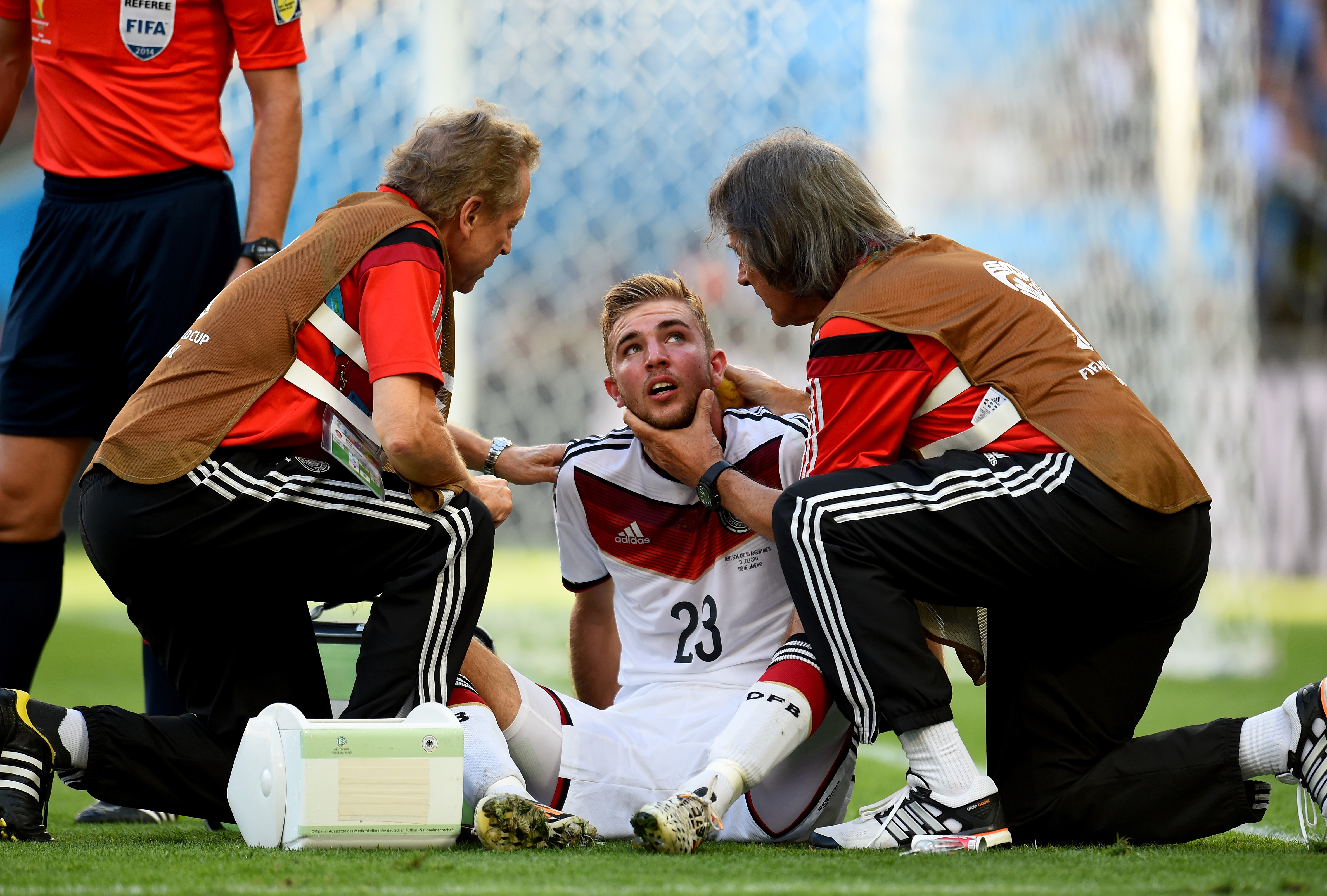 Christoph Kramer of Germany receives a medical treatment during the 2014 FIFA World Cup Brazil Final match between Germany and Argentina on July 13, 2014 in Rio de Janeiro.