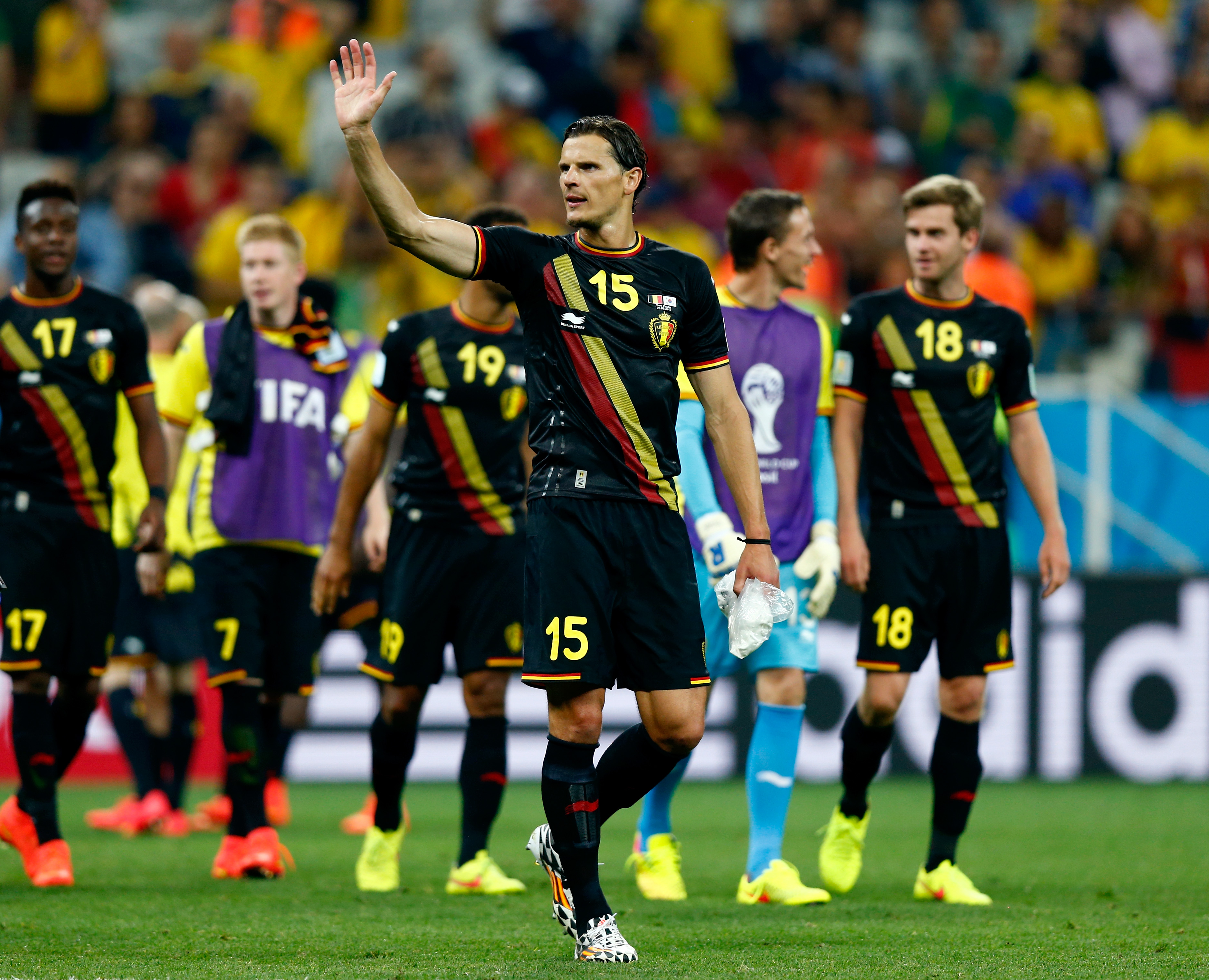 Daniel Van Buyten of Belgium acknowledges the fans after a 1-0 victory in a 2014 FIFA World Cup Brazil match against South Korea on June 26 in Sao Paulo, Brazil.