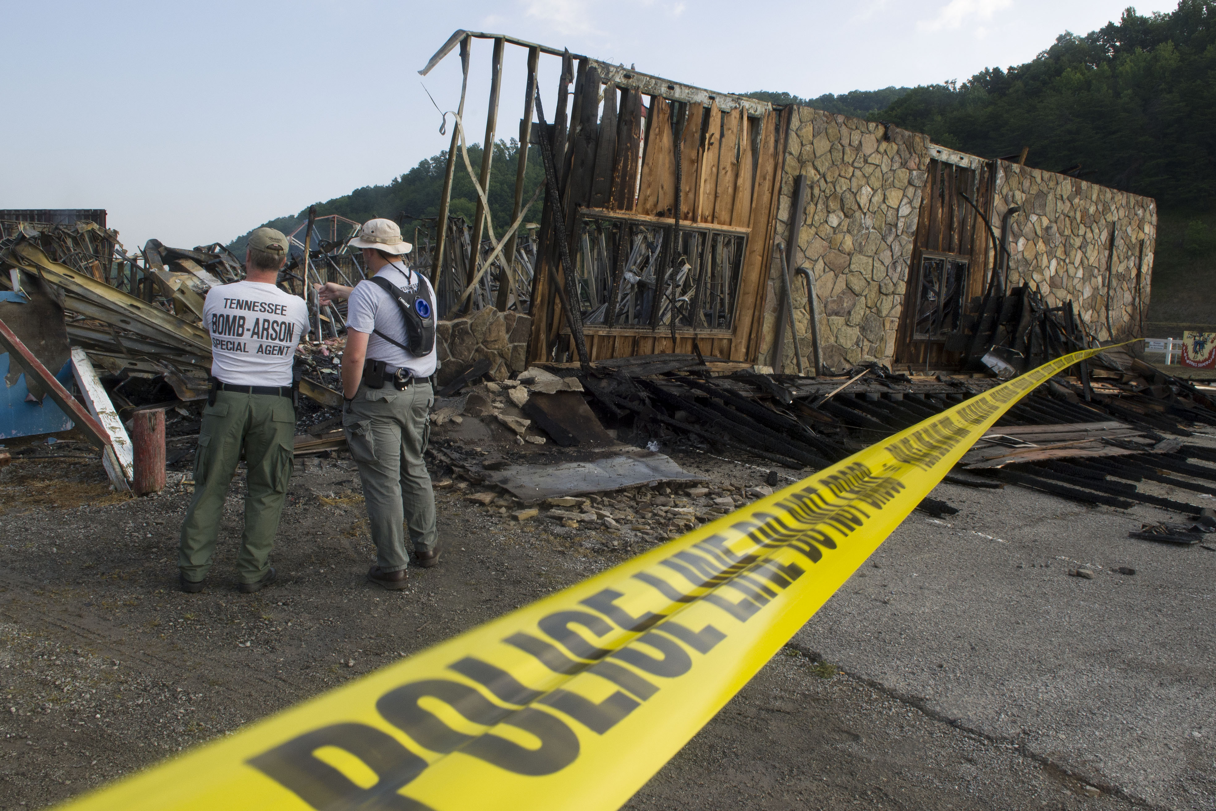 Tennessee Bomb and Arson Special Agents Don Cogan, left and Jason Poore survey the destroyed Fireworks Superstore in Caryville, Tenn. on July 7, 2014.
