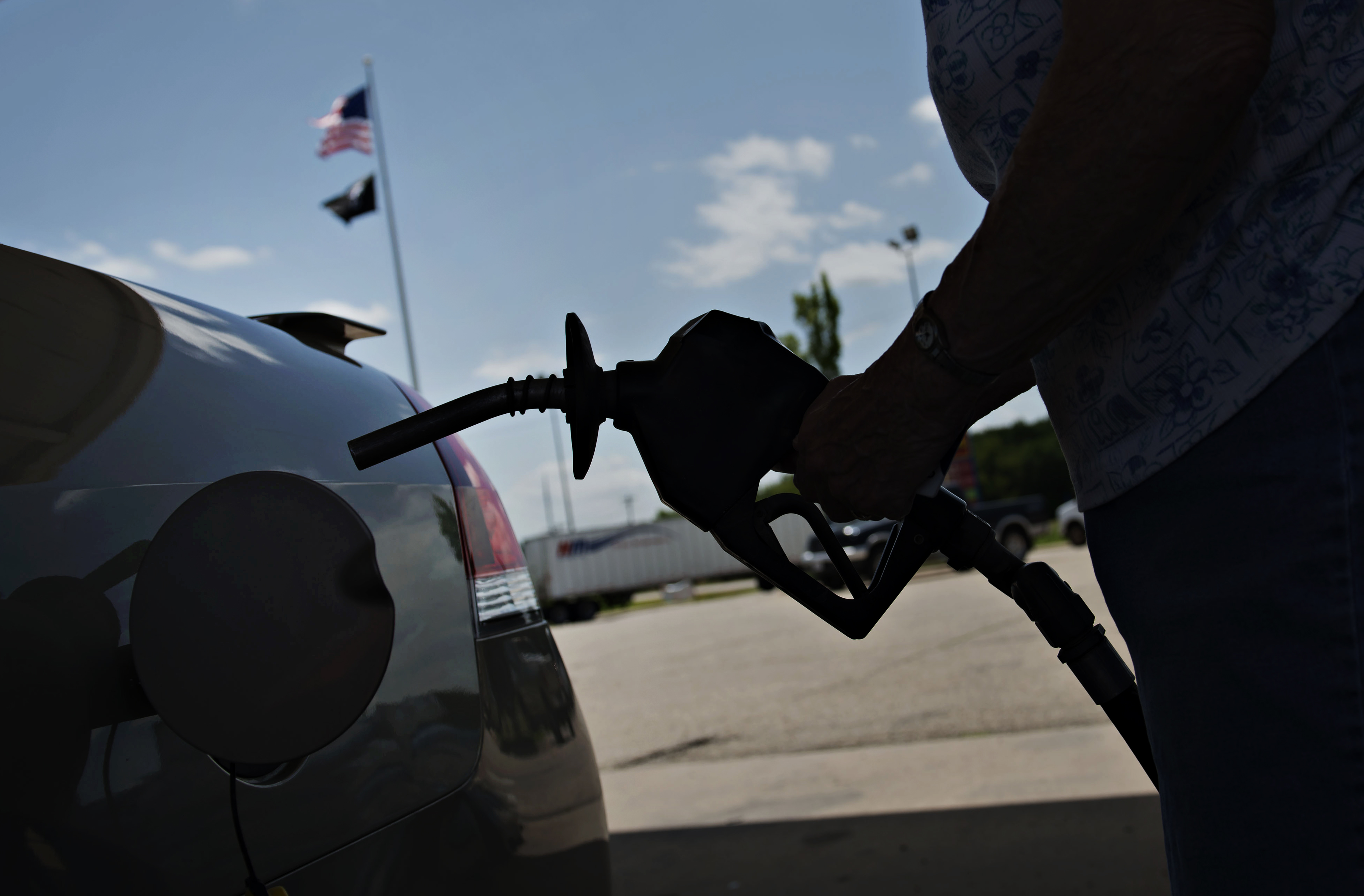 A customer prepares to fuel her vehicle at a Road Ranger gas station in Princeton, Illinois, on June 17, 2014.