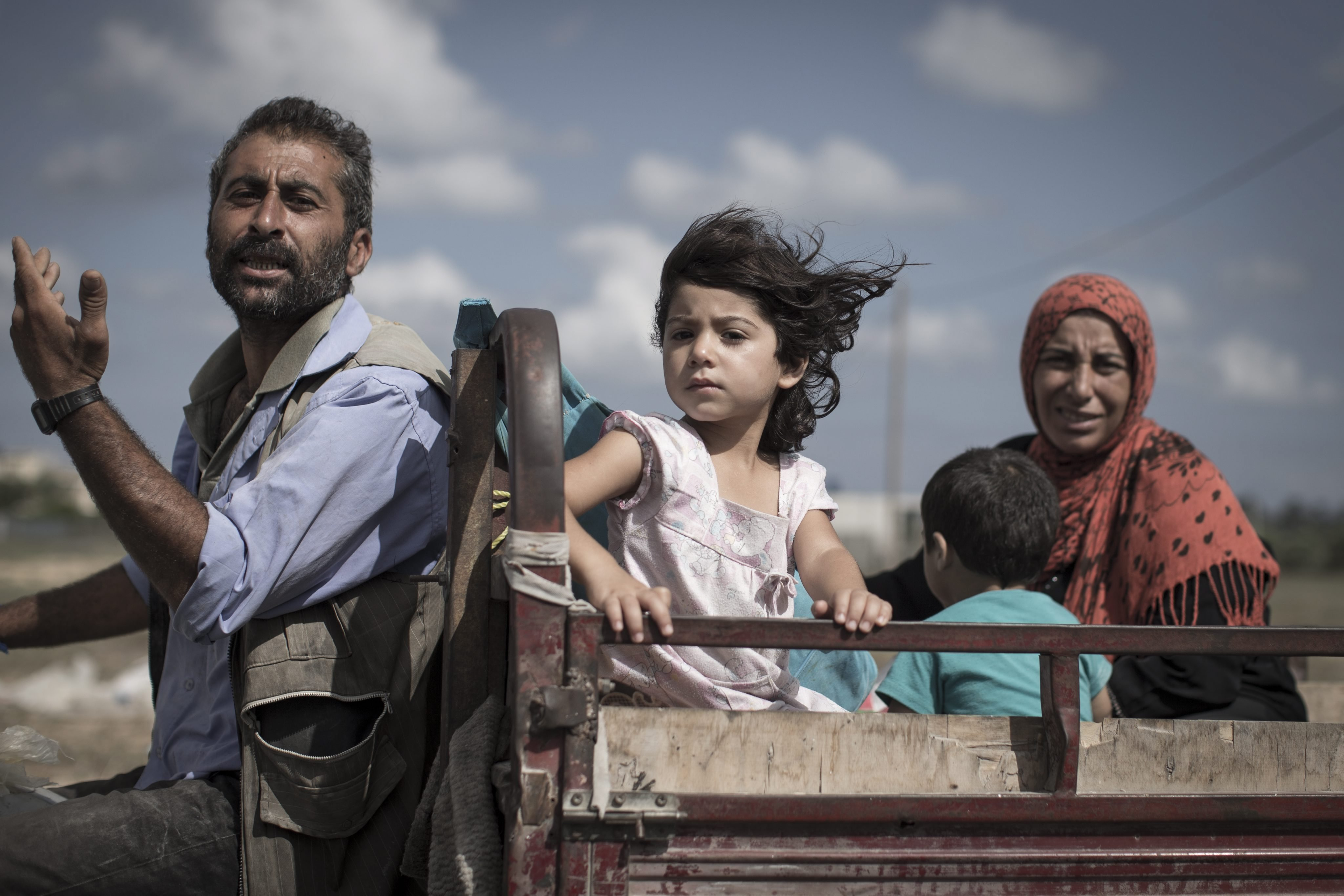 A Palestinian family who fled their homes is en route to seek shelter in a UN school in Khan Younis, Gaza Strip on July 18, 2014.