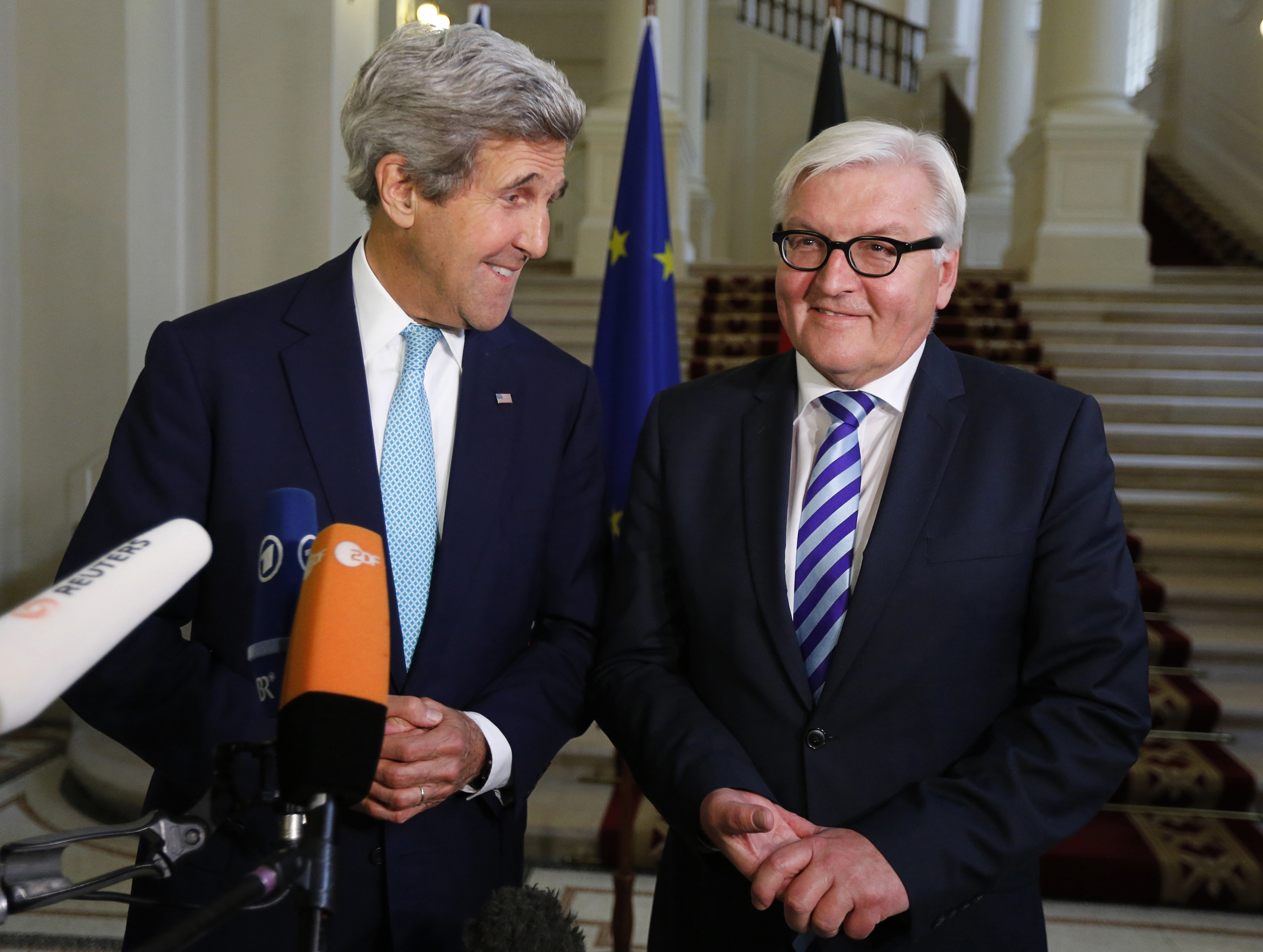 U.S. Secretary of State John Kerry, left and German Foreign Minister Frank-Walter Steinmeier during a press conference, after talks between the foreign ministers of the six powers negotiating with Tehran on its nuclear program, in Vienna, Austria on July 13, 2014.