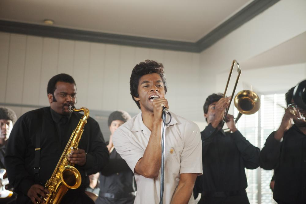 Left: Craig Robinson, center: Chadwick Boseman (as James Brown), Get On Up, 2014.