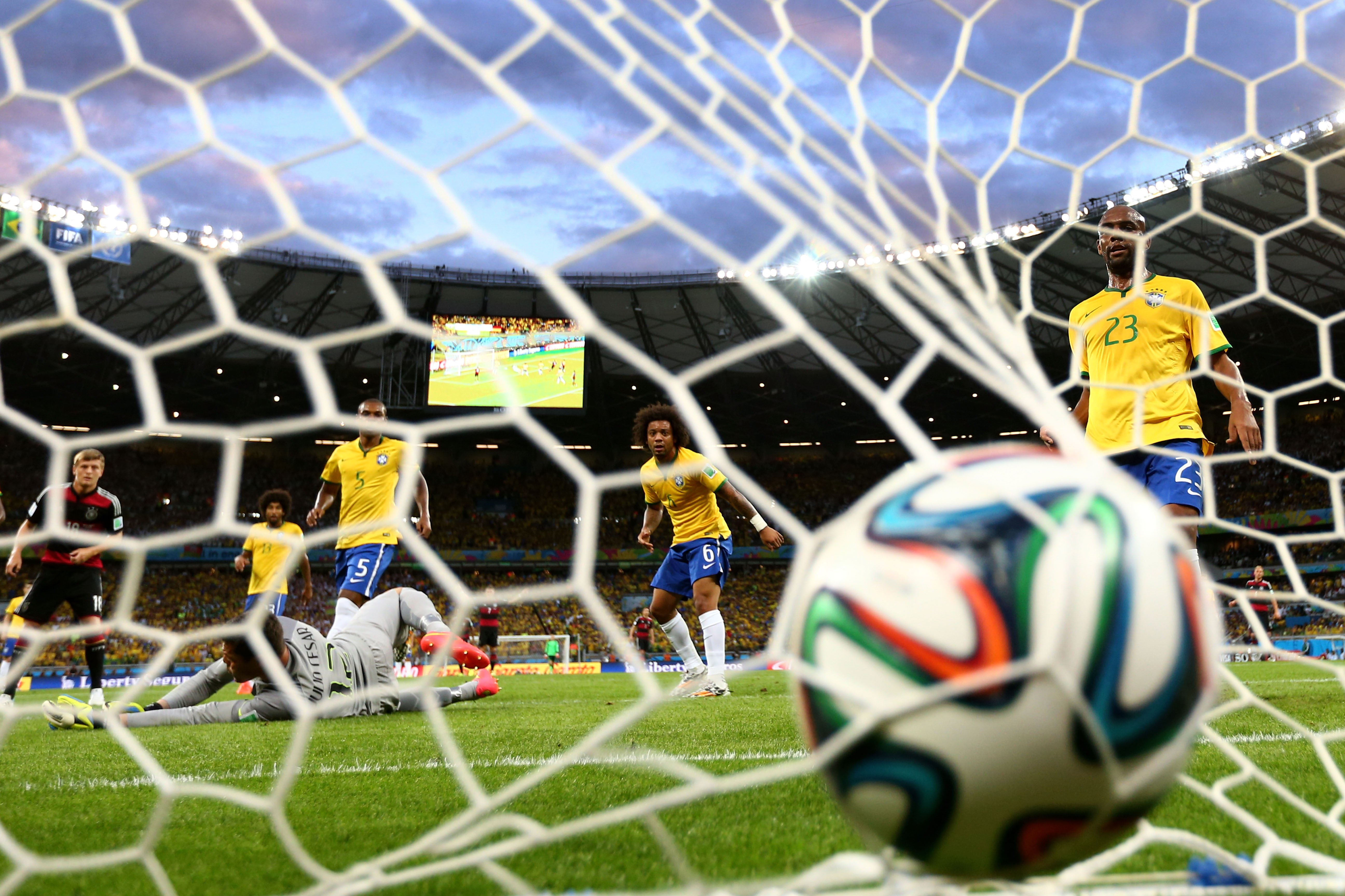 Miroslav Klose of Germany scores his team's second goal past Julio Cesar of Brazil during the 2014 FIFA World Cup Brazil Semi Final match between Brazil and Germany at Estadio Mineirao on July 8, 2014 in Belo Horizonte, Brazil.