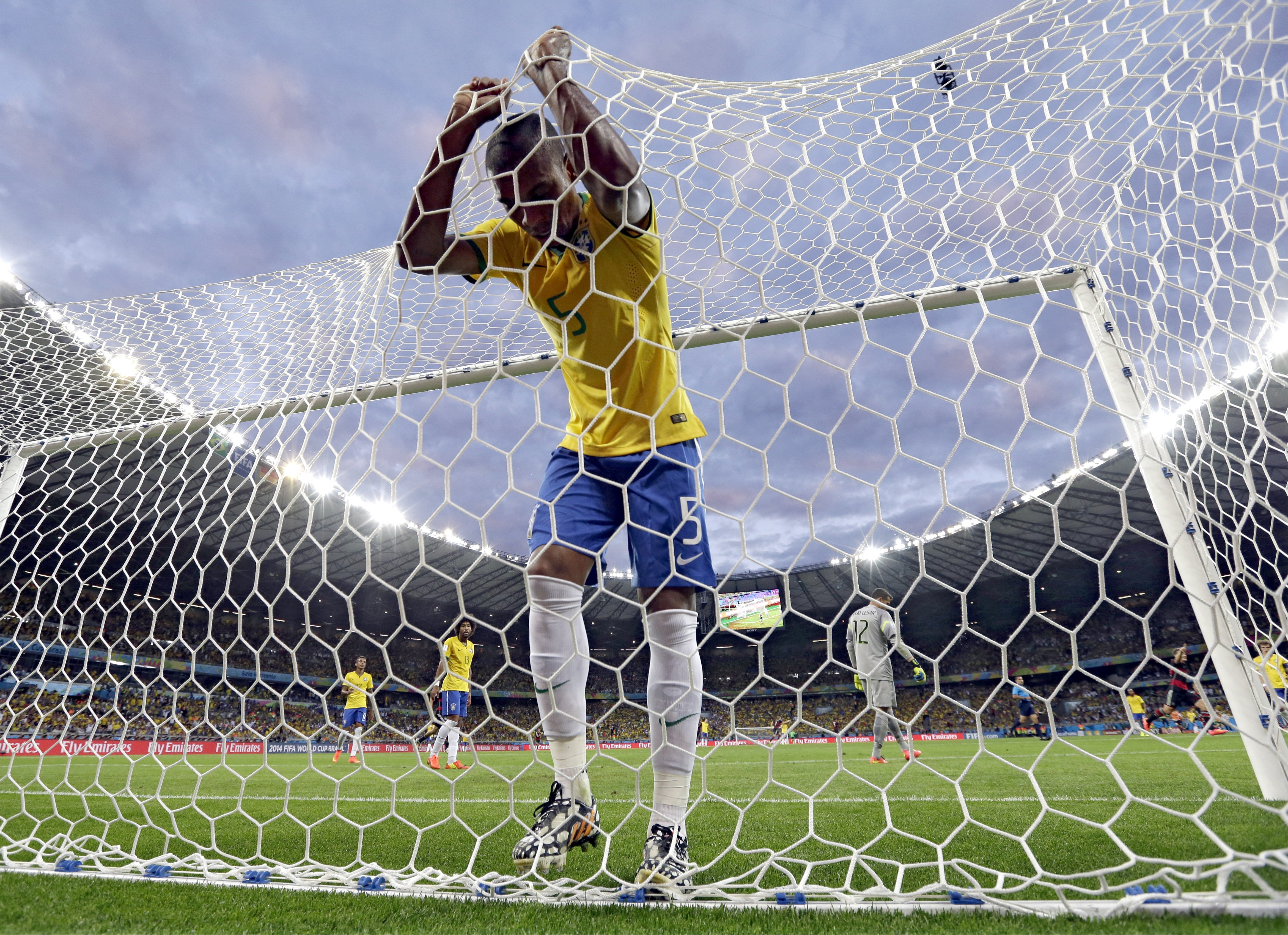 Brazil's Fernandinho reacts after Germany's Toni Kroosduring scored his side's third goal at the Mineirao Stadium in Belo Horizonte, Brazil on July 8, 2014.
