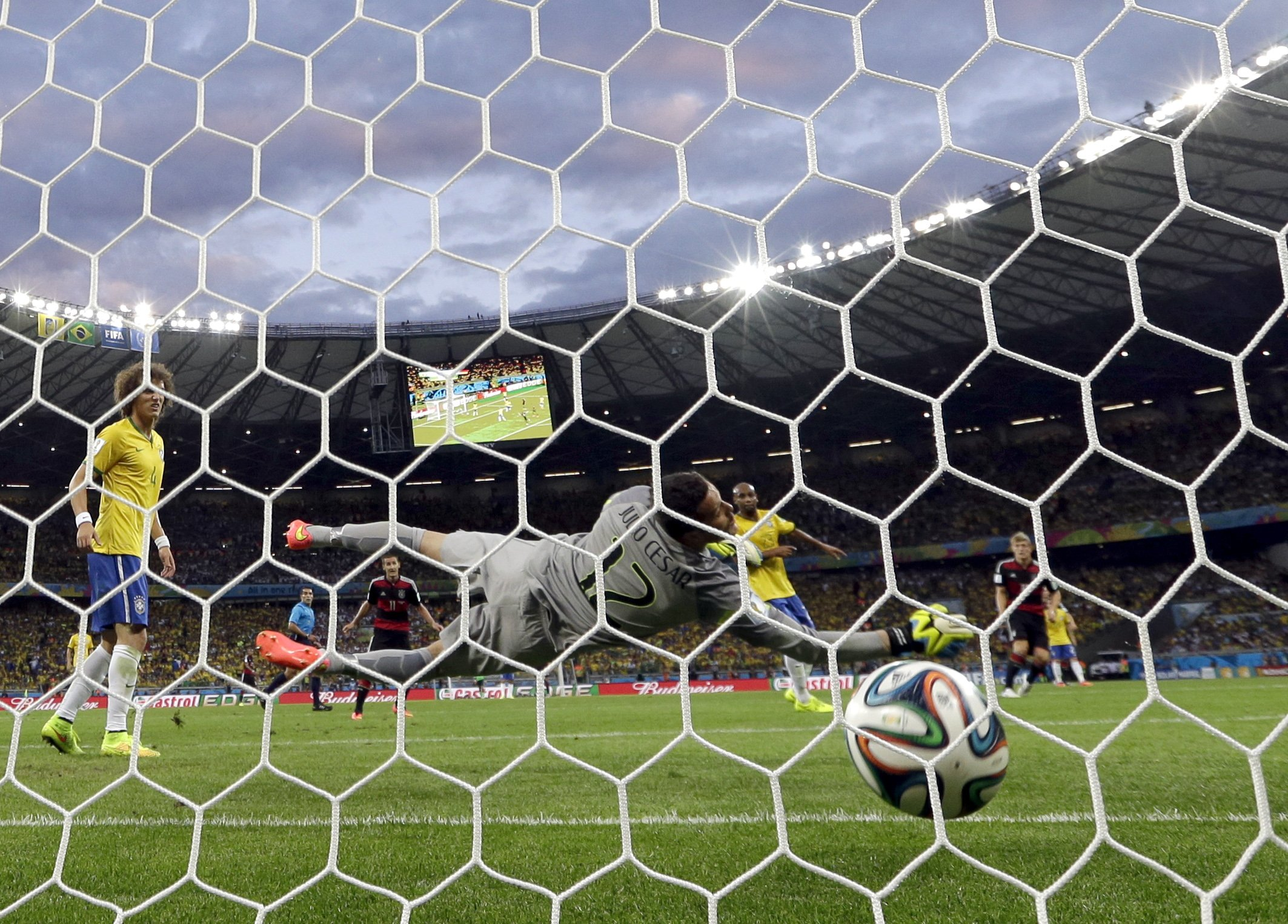 Brazil's goalkeeper Julio Cesar can not stop a shot by Germany's Toni Kroos to score his side's fourth goal at the Mineirao Stadium in Belo Horizonte, Brazil on July 8, 2014.