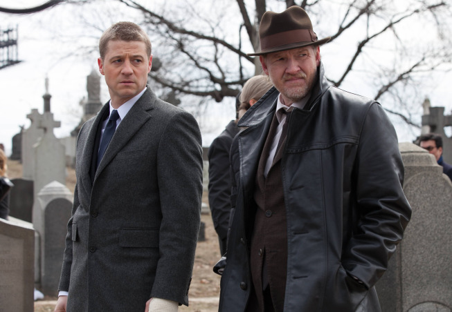 Detective Jim Gordon (Ben McKenzie) and Detective Harvey Bullock (Donal Logue) in  Gotham.