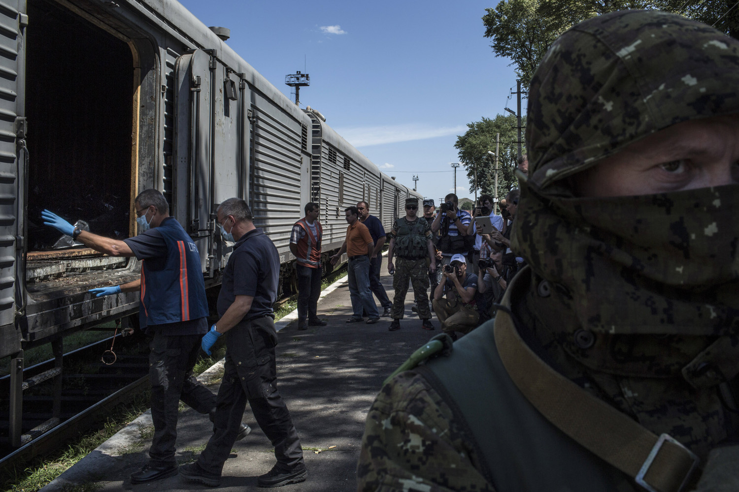 Jul. 21, 2014. Members of a Dutch forensics team prepare to inspect rail cars where the bodies of the Malaysia Airlines Flight 17 crash victims were being held in Torez, Ukraine.
