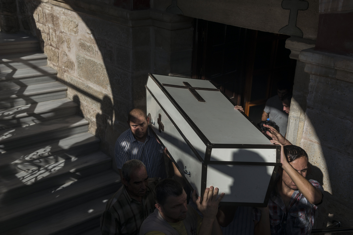 Jul. 27, 2014. Relatives of Jalila Ayyad, a Christian woman who was reportedly killed during an airstrike, carry her coffin during her funeral at the Church of Saint Porphyrius in Gaza City.