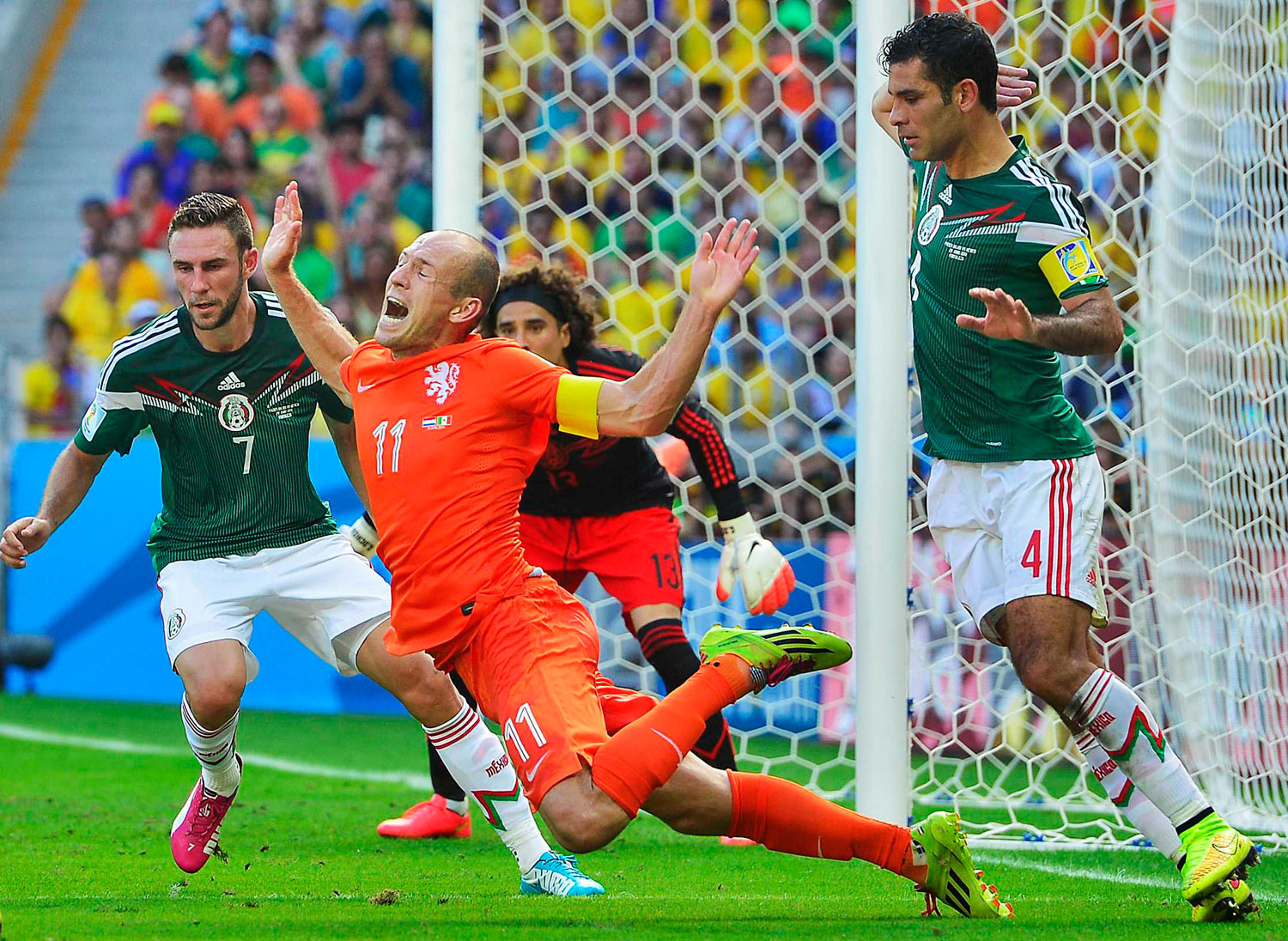 Netherlands vs. Mexico                                                              Mexico's Rafael Marquez fouls Arjen Robben of the Netherlands in the box at the Estadio Castelao in Fortaleza, Brazil on June 29, 2014.
