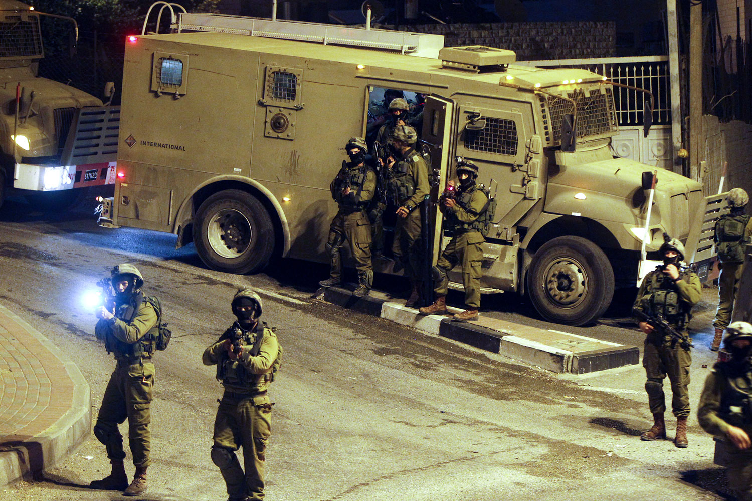 Israeli military patrols the streets in the West Bank city of Hebron on July 6, 2014