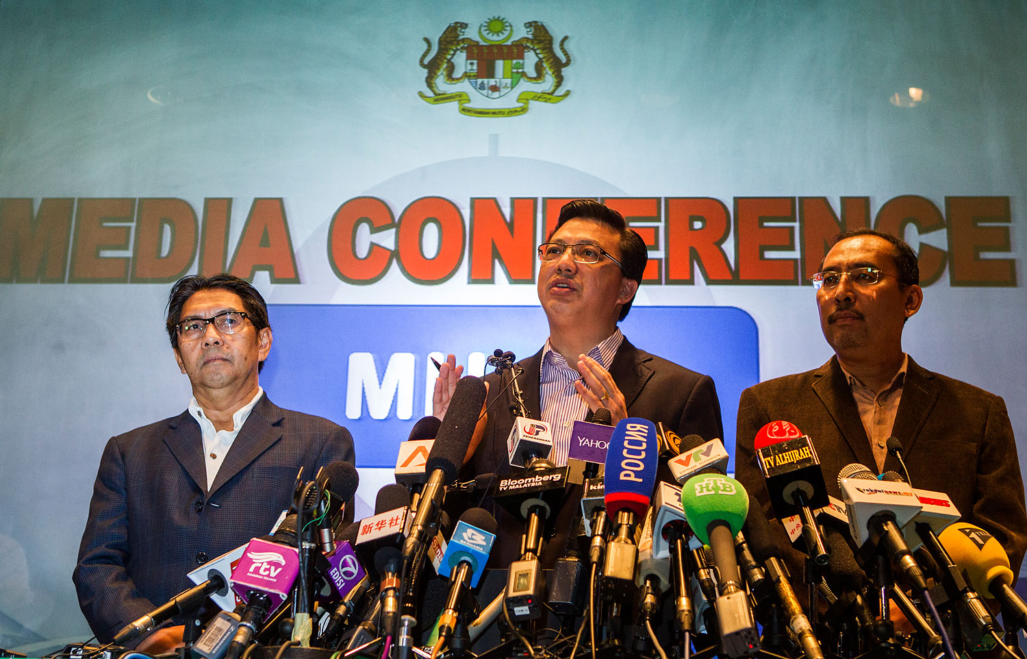 Malaysian Transport Minister Liow Tiong Lai, center, and civil-aviation chief Azharuddin Abdul Rahman, right, speak during a media conference on Malaysian Airlines Flight MH17 at Kuala Lumpur International Airport on July 19, 2014