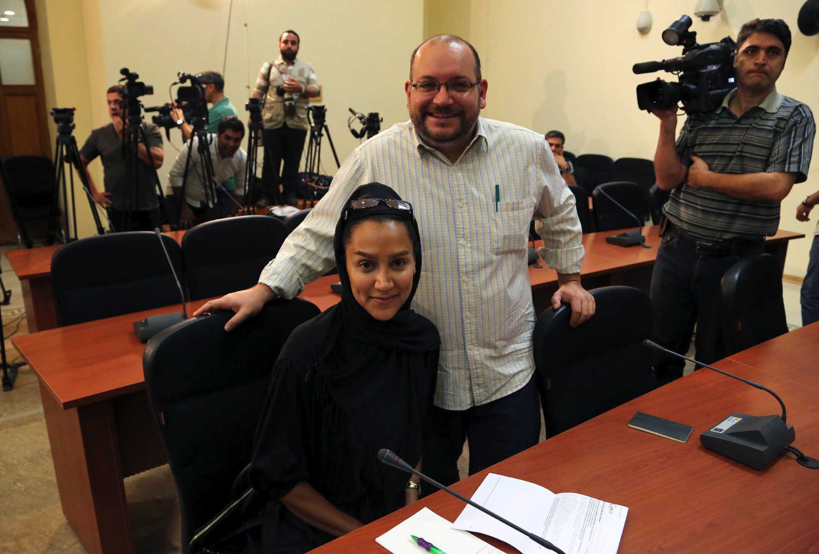 Washington Post Iranian-American journalist Jason Rezaian, right, and his Iranian wife Yeganeh Salehi, who works for the the National, an UAE newspaper, during a Foreign Ministry weekly press conference in Tehran on Sept. 10, 2013