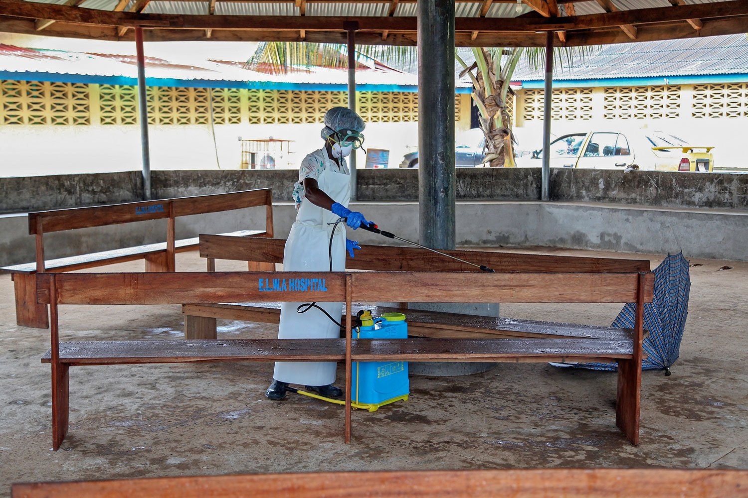 A nurse disinfects the waiting area for visitors at the ELWA Hospital in Monrovia, Liberia, on July 28, 2014