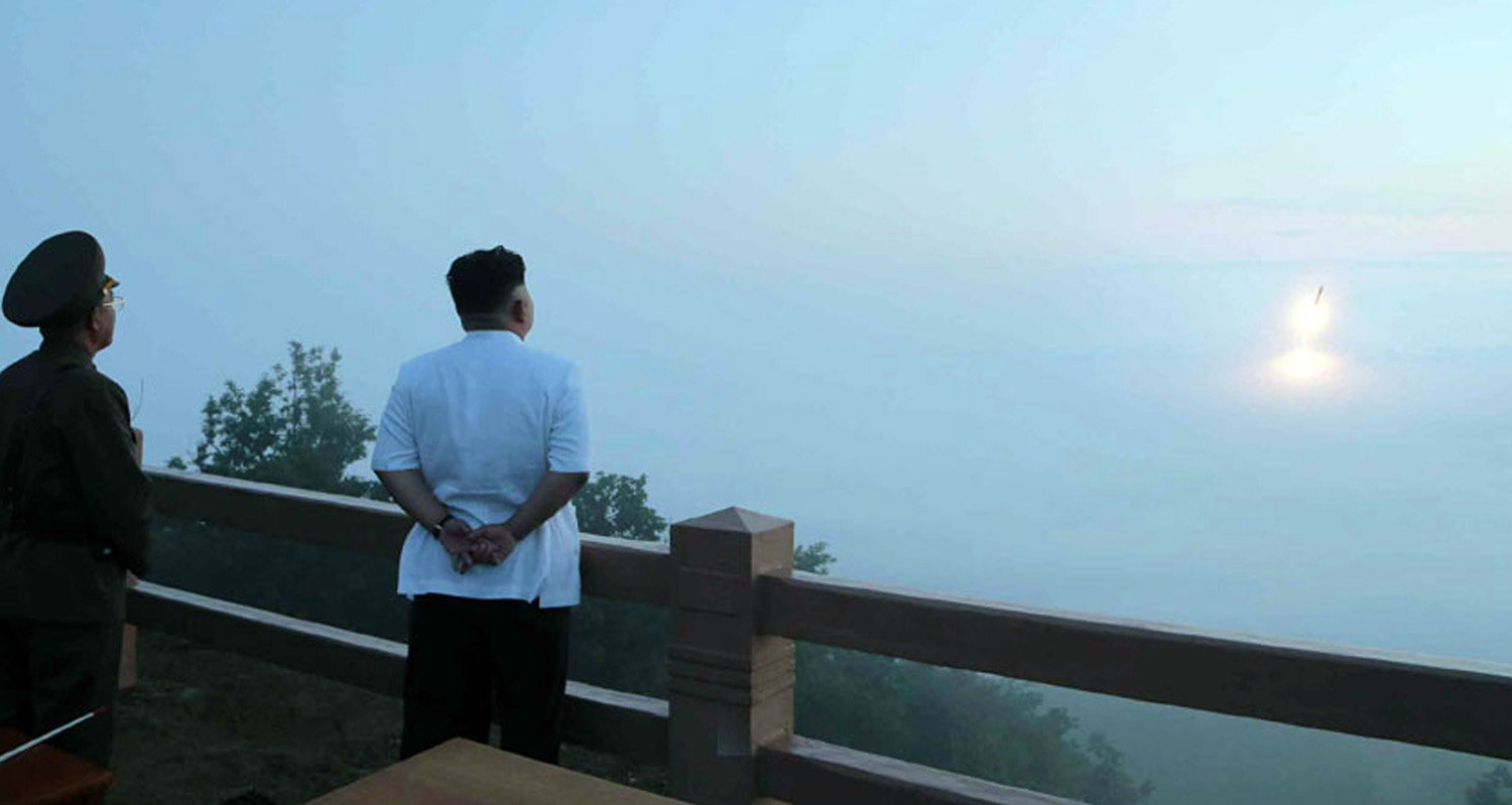 Jun. 30, 2014. North Korean leader Kim Jong-Un (R) observing a tactical rocket launch by the Korean People's Army Strategic Force at an undisclosed place in North Korea.