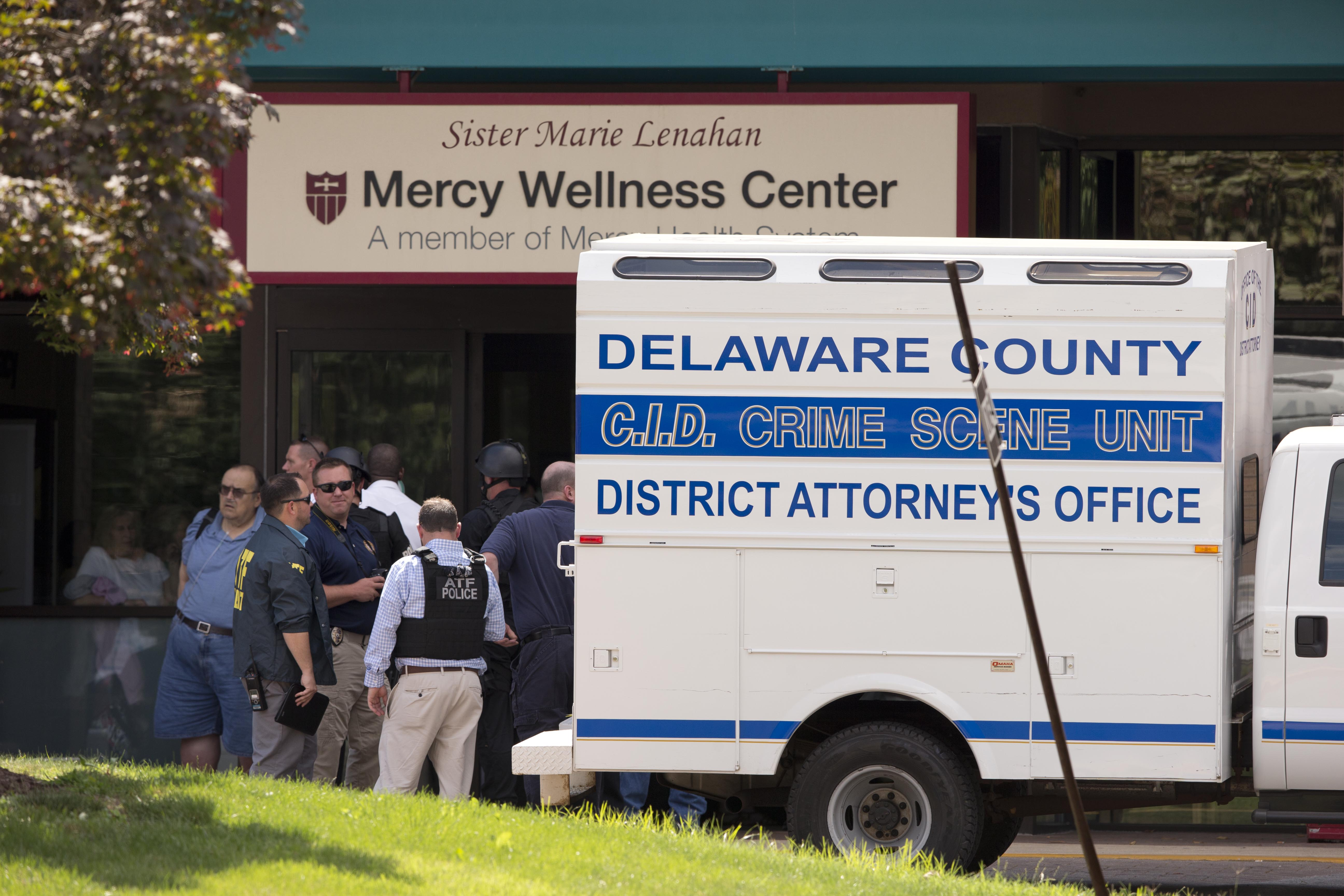 Investigators work the scene of a shooting Thursday, July 24, at Mercy Fitzgerald Hospital in Darby, Pa.