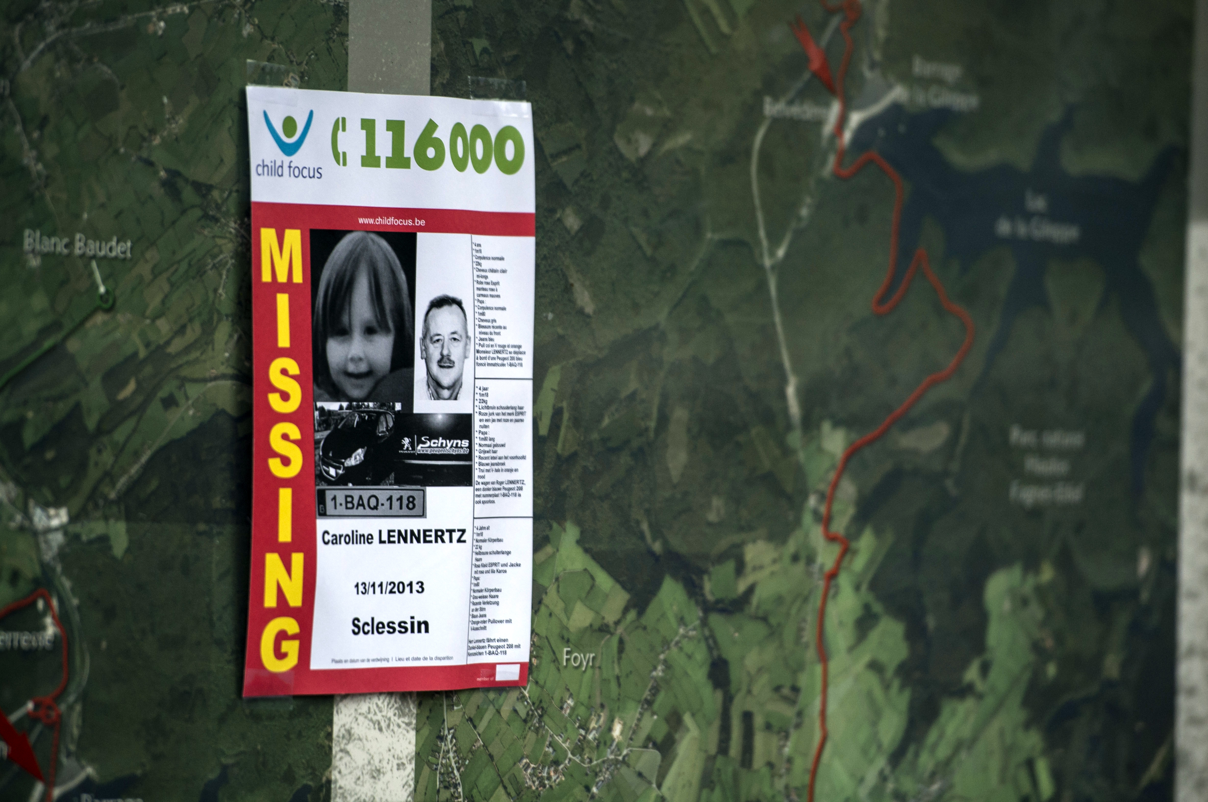A Child Focus poster displayed during the ongoing search for a missing father and daughter in Belgium reported missing in November 2013.