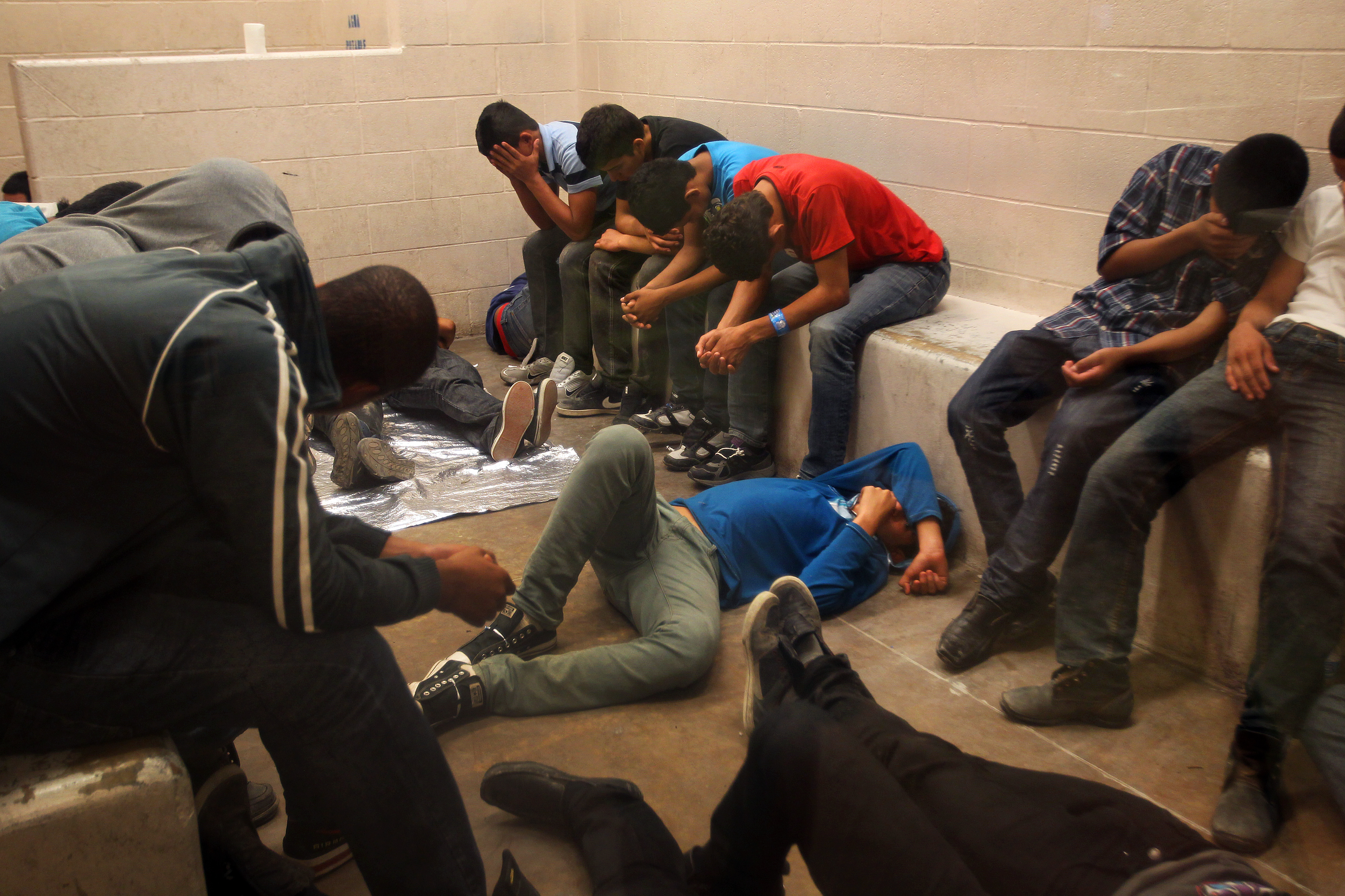 Immigrants who have been caught crossing the border illegally are housed inside the McAllen Border Patrol Station in McAllen, Texas where they are processed on July 15, 2014 in McAllen, Texas.