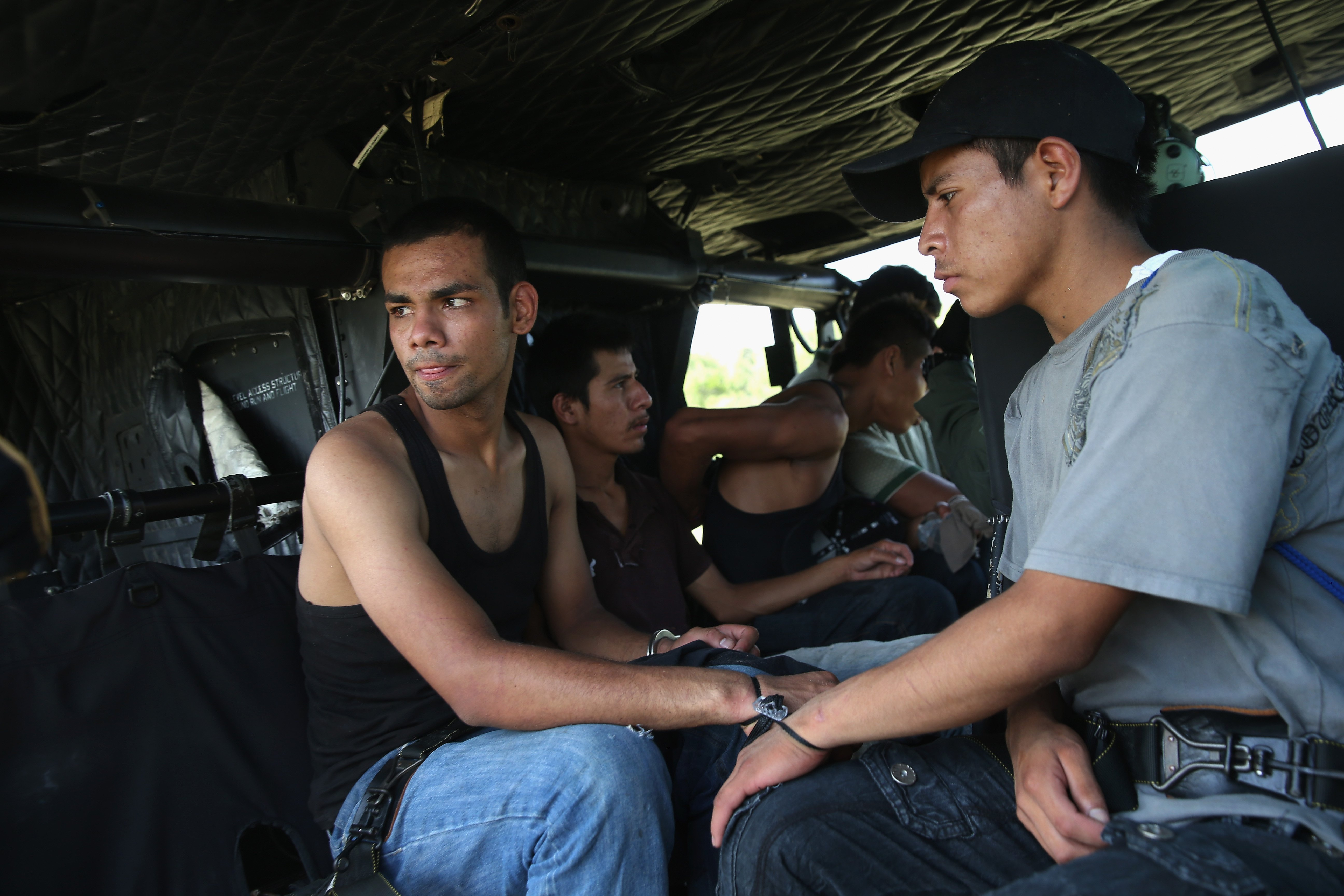 Undocumented immigrants are transported to a U.S. Customs and Border Protection processing center after being detained near Falfurrias, Texas on July 22, 2014.